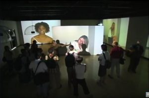 site view of 5-channel video installation in a large art gallery