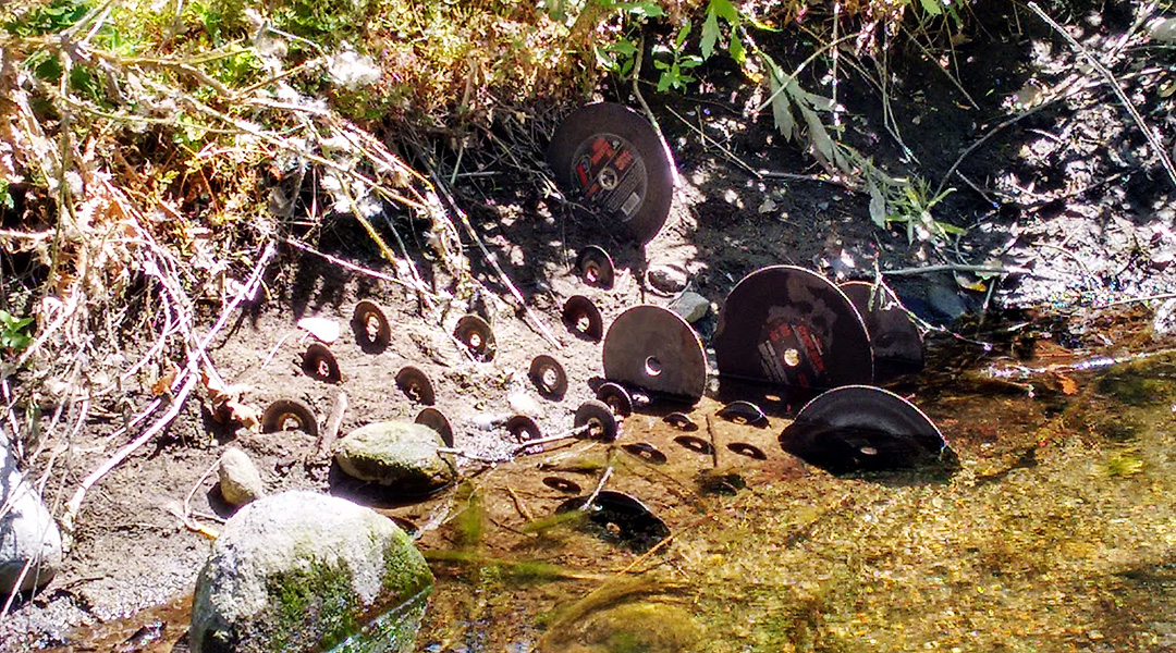 "installation of ""chop wheels"" on the bank of a finger of the south fork of the Kaweah River in Three Rivers, CA"