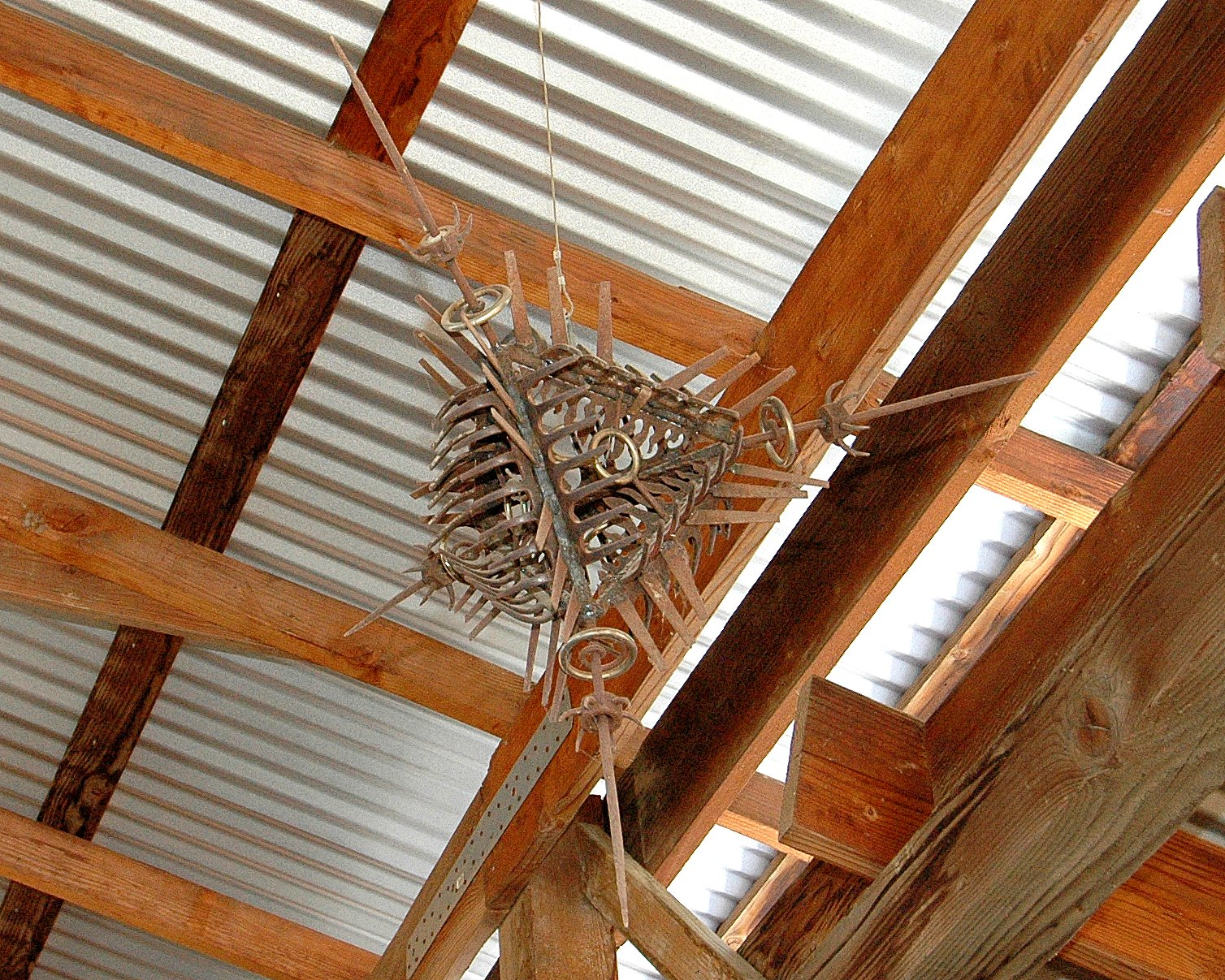 """an articulated, dense, aggressive """"Tetrahedron in Disguise"""" made of welded steel elements"""