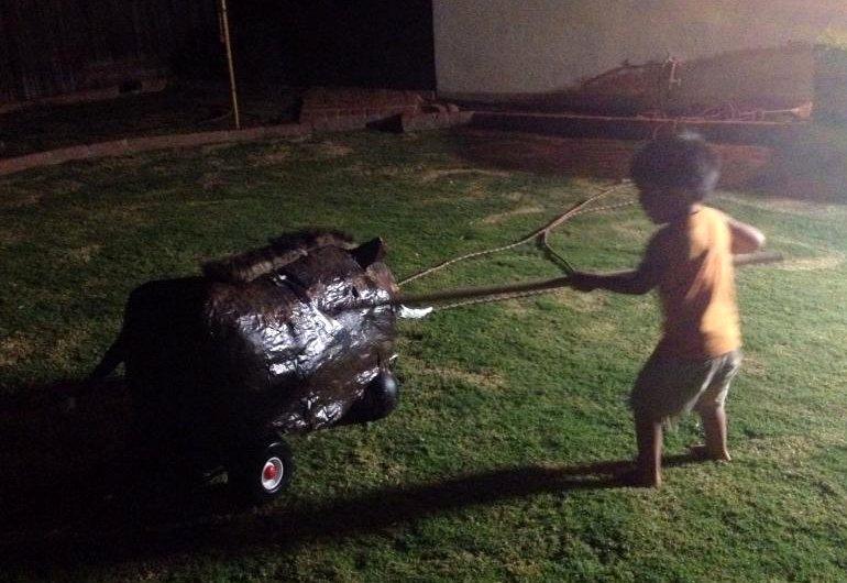 throwing a wooden spear at a papier mache boar in Bob & Rachel Hernandez' back yard in Hacienda Heights, CA