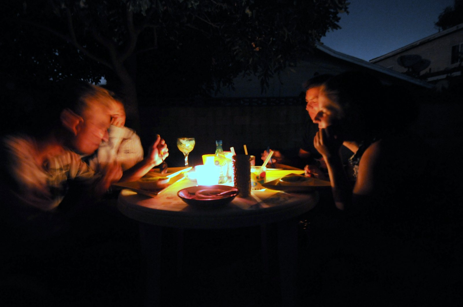 Denes, Csenge, Akos & Eszter around the backyard table