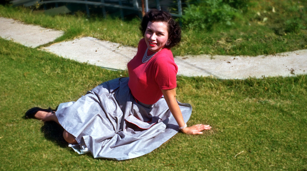 Vintage photo of Sheila Zucman sitting on the grass