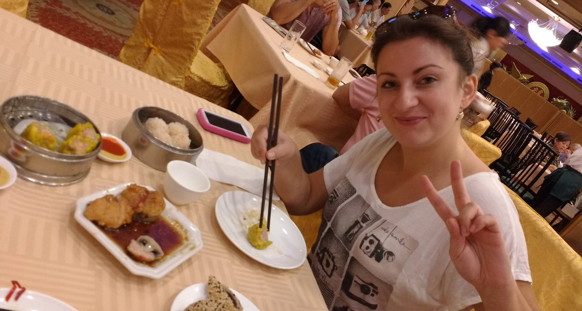 woman eating dim sum with chop sticks
