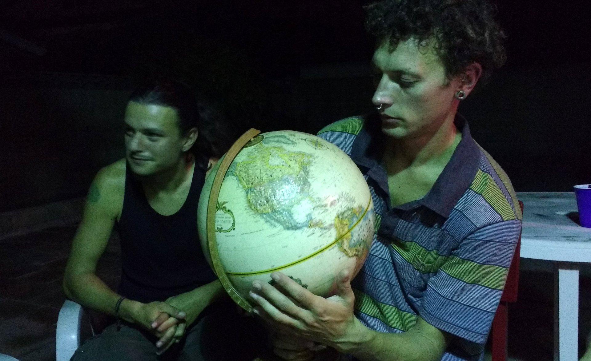 Antonio holding a globe