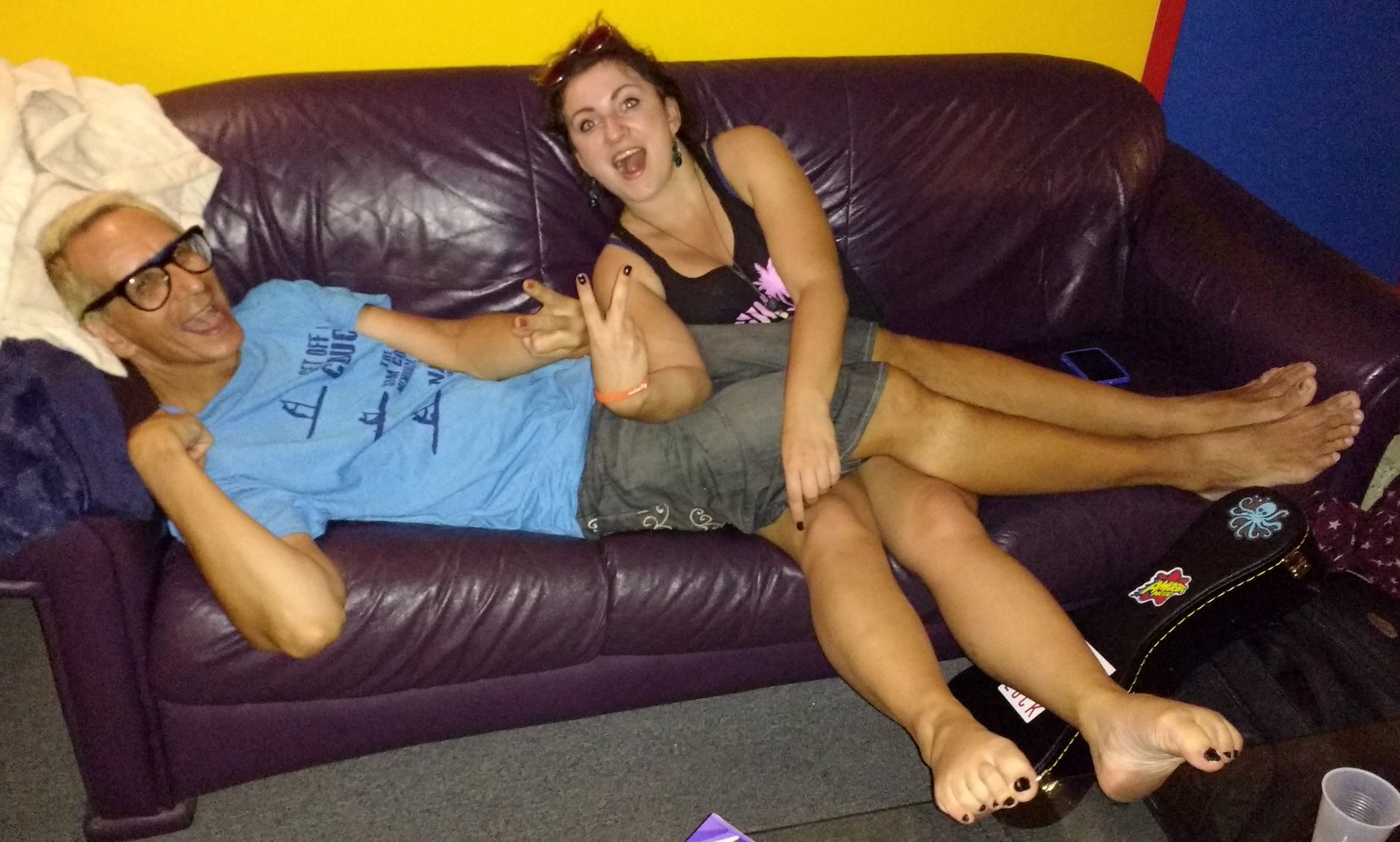 Glenn & Elena relaxing on the purple couch in the living room