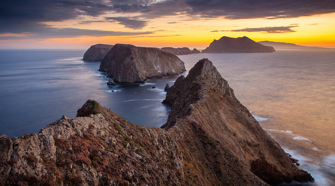 Inspiration Point, East Anacapa Island, California. View from East Anacapa looking toward Middle Anacapa at Sunset.