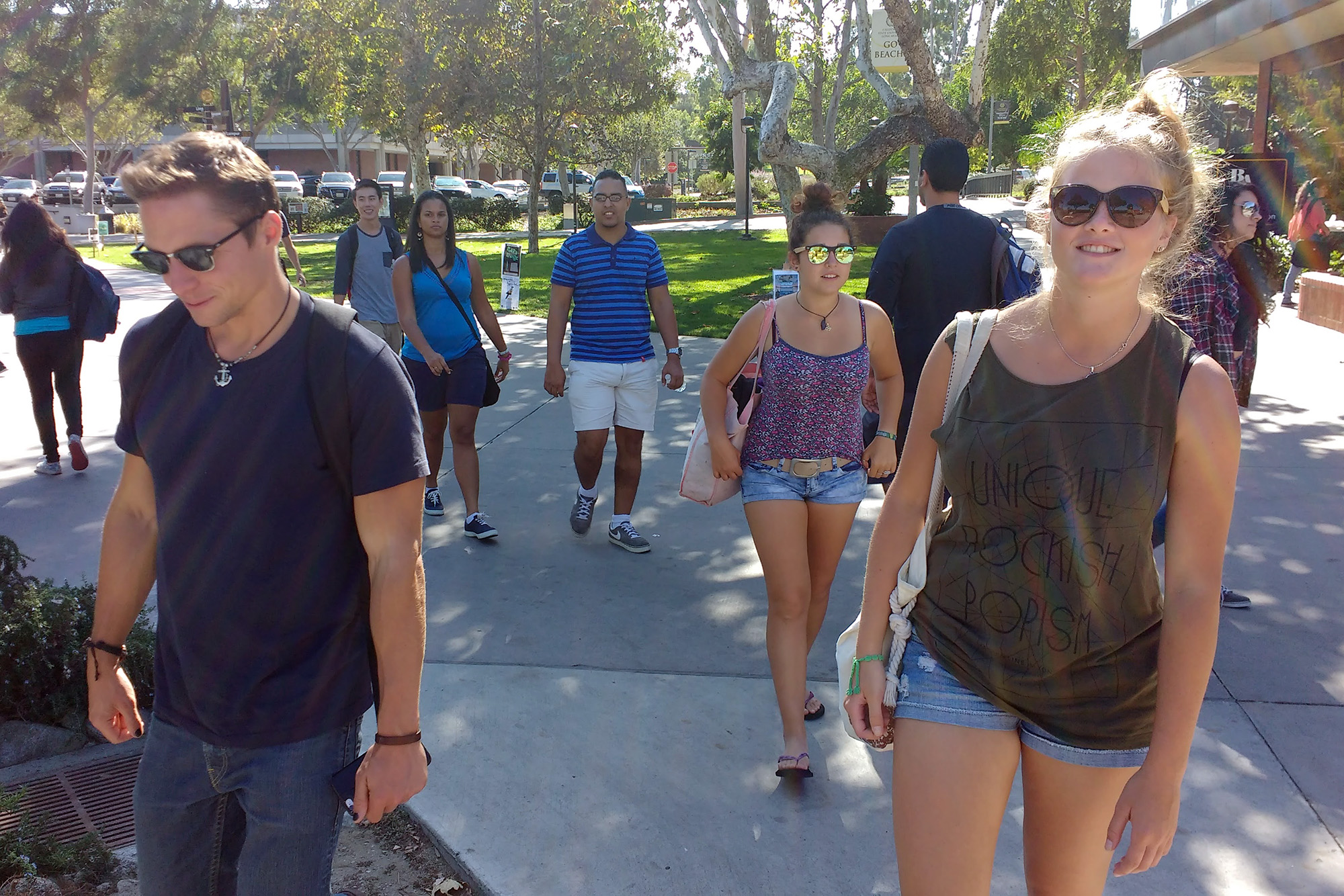 5 people walking across the Long Beach State campus.