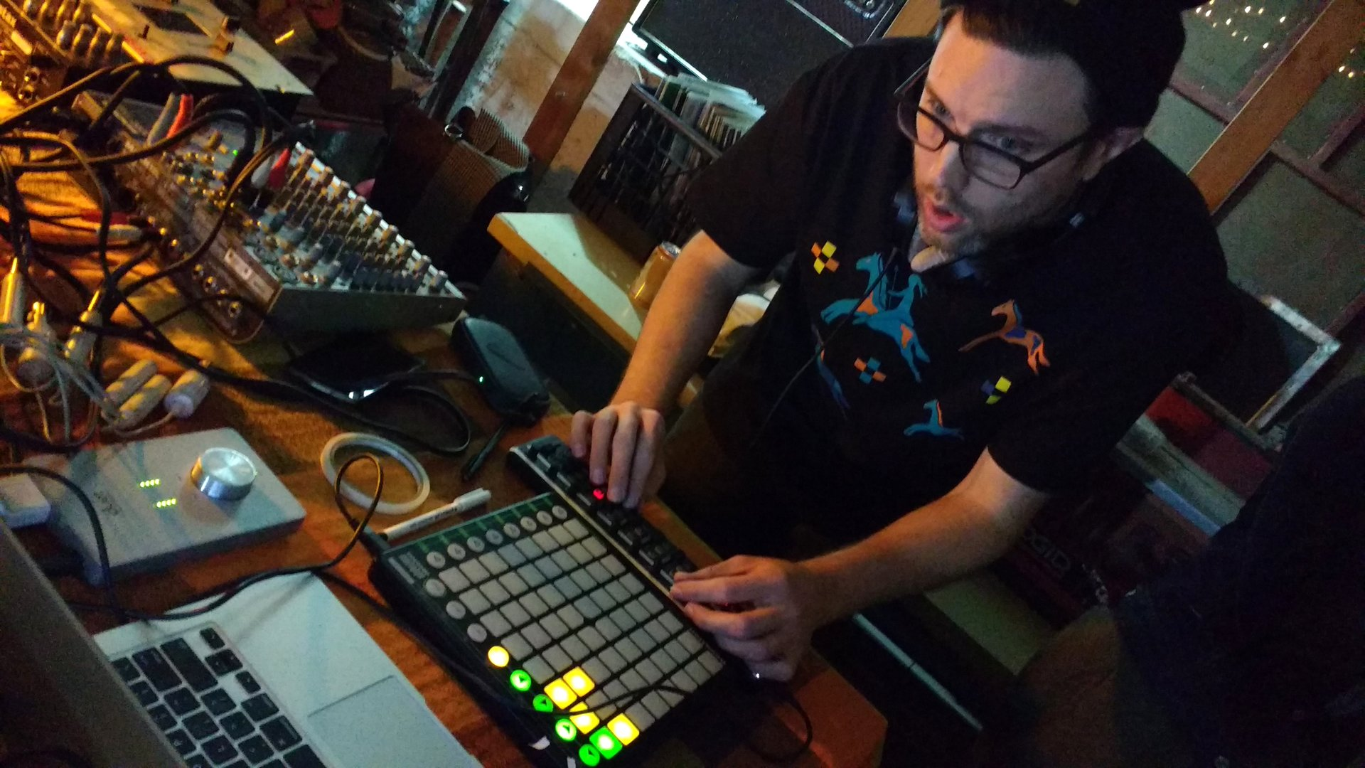 DJ using a sample board