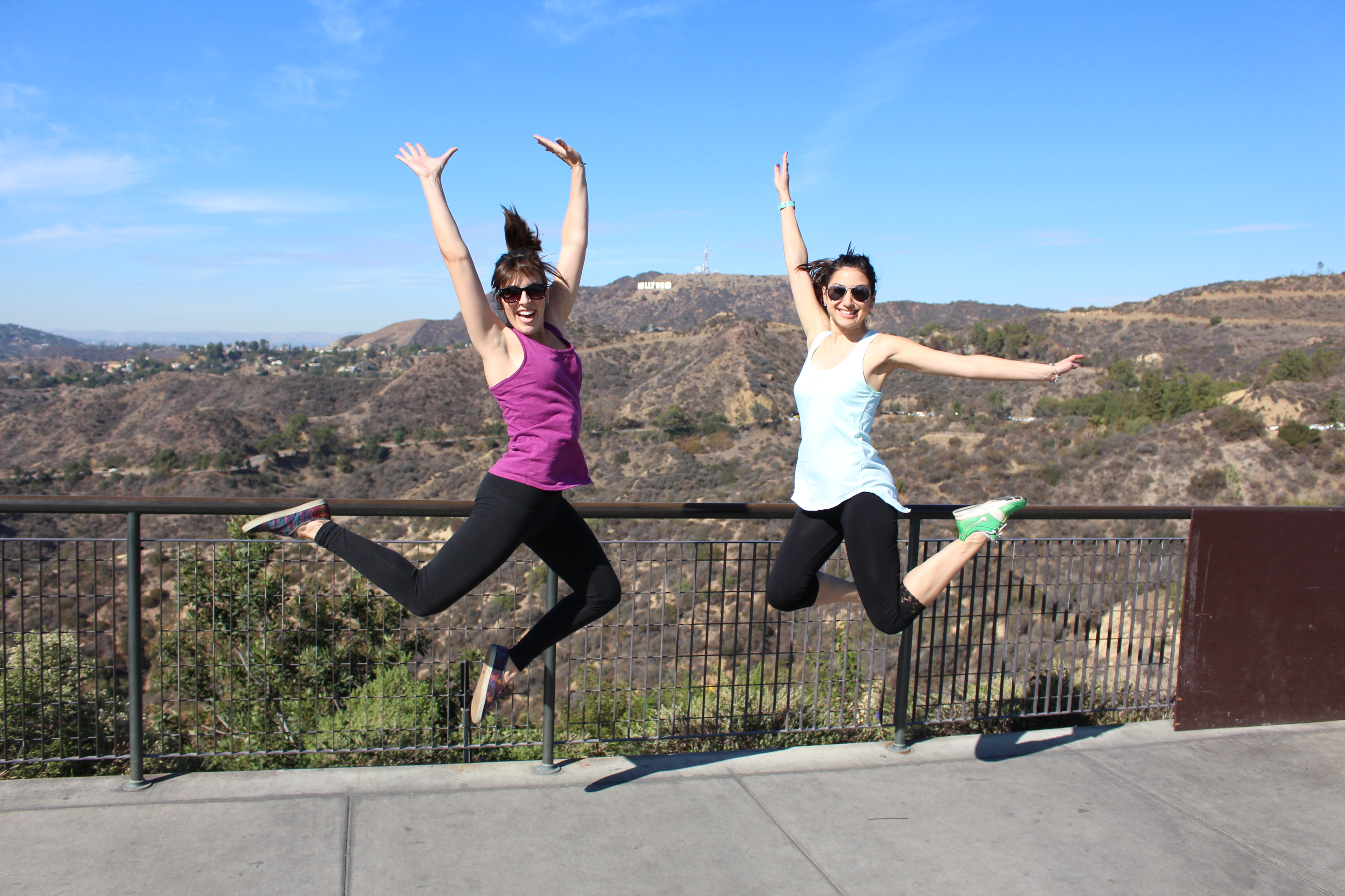 Kamal & Rebecca jumping in front of the Hollywood Sign