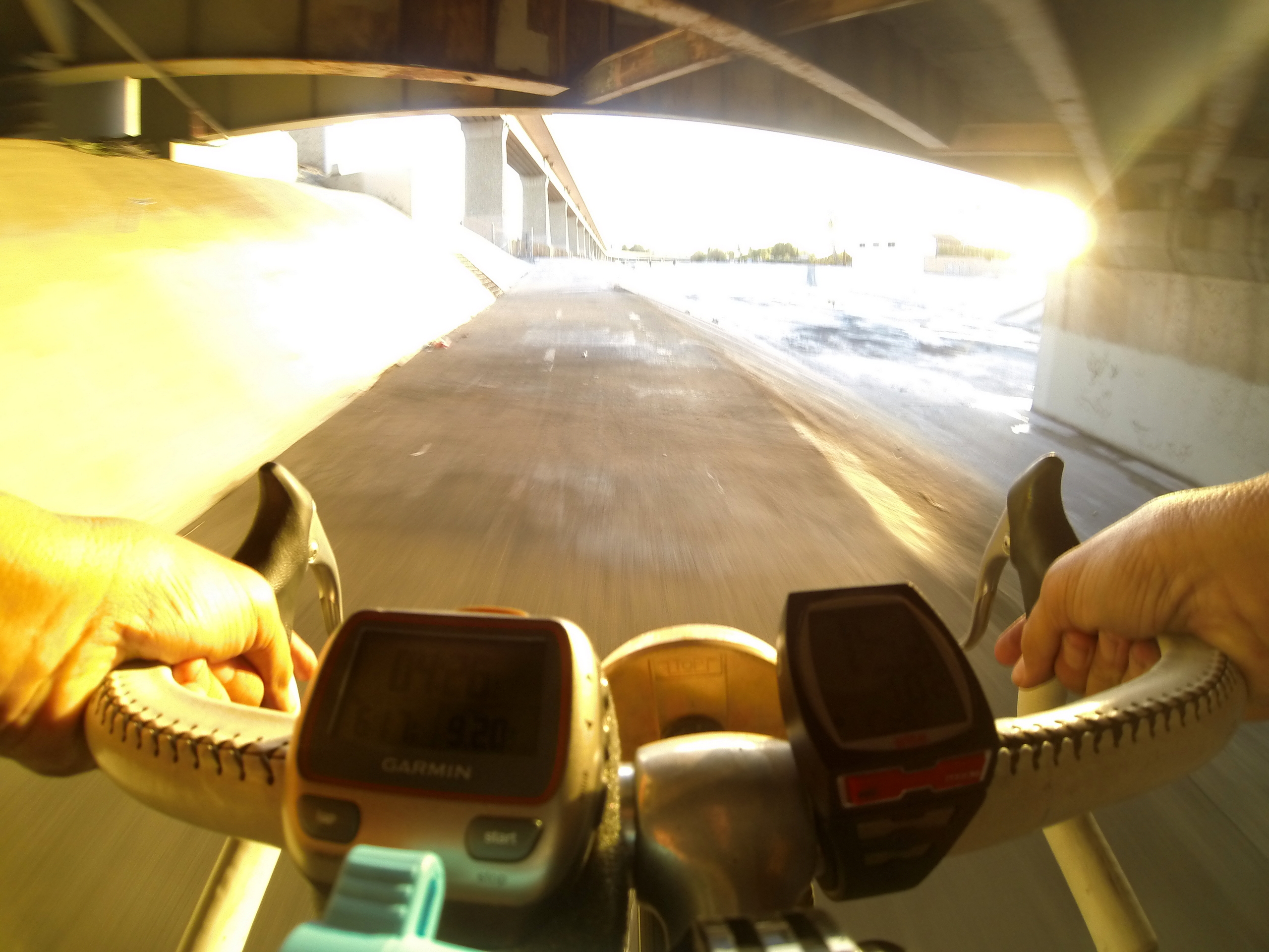 GoPro picture with camera mounted on my 10-speed handlebars looking out to the road