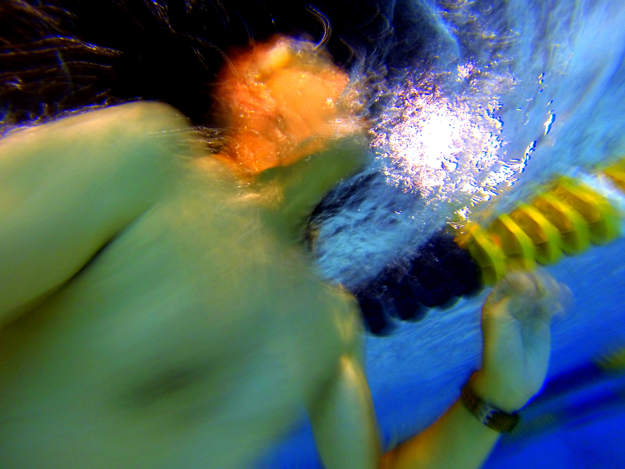 underwater GoPro shot of  me moving across a lane in an Olympic size swimming pool