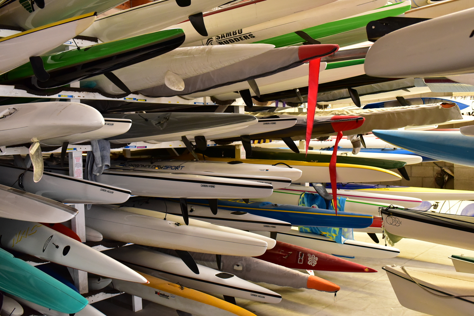 surf skis and outrigger canoes on a large rack