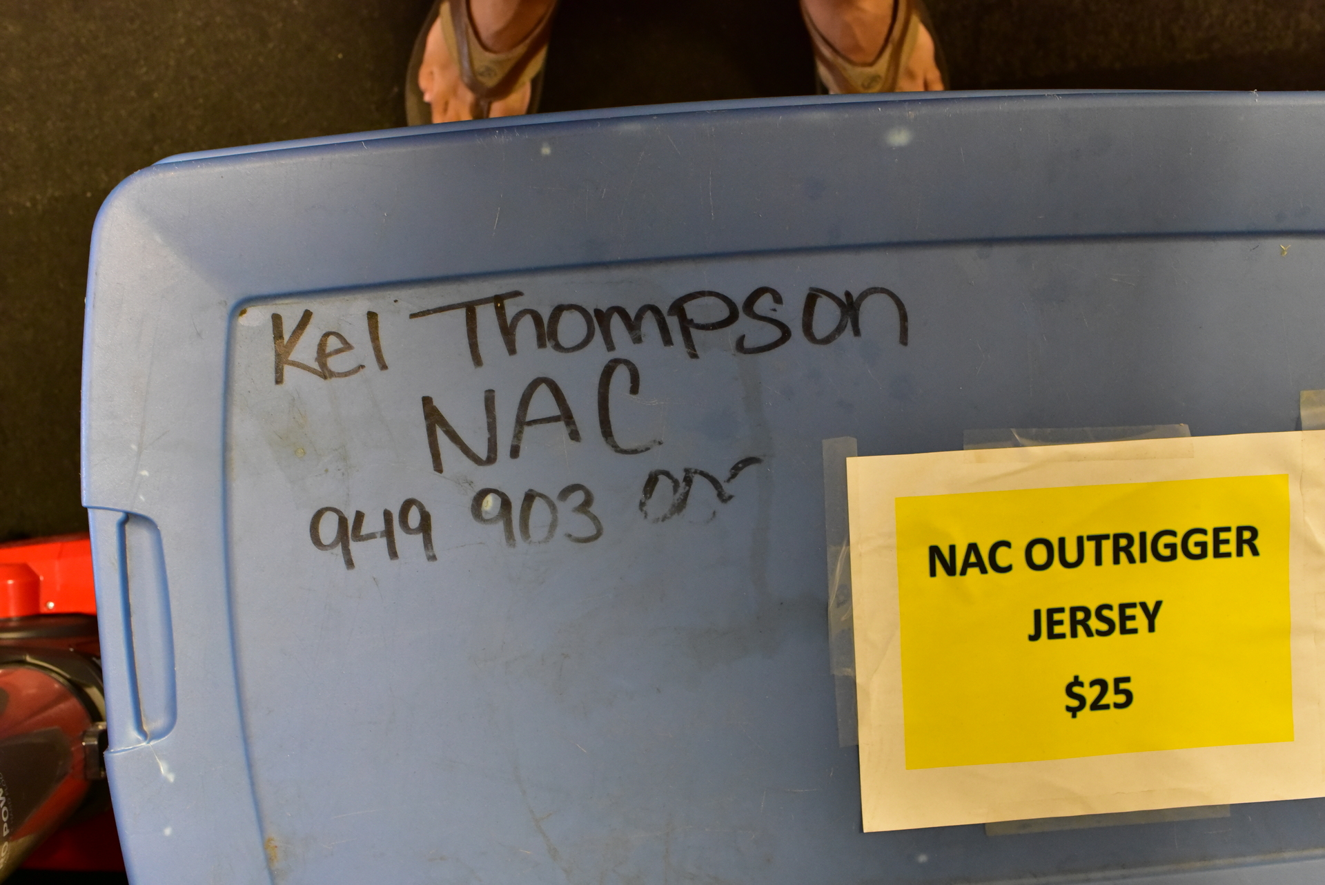 plastic storage tub with Kelly Thompson's name on it