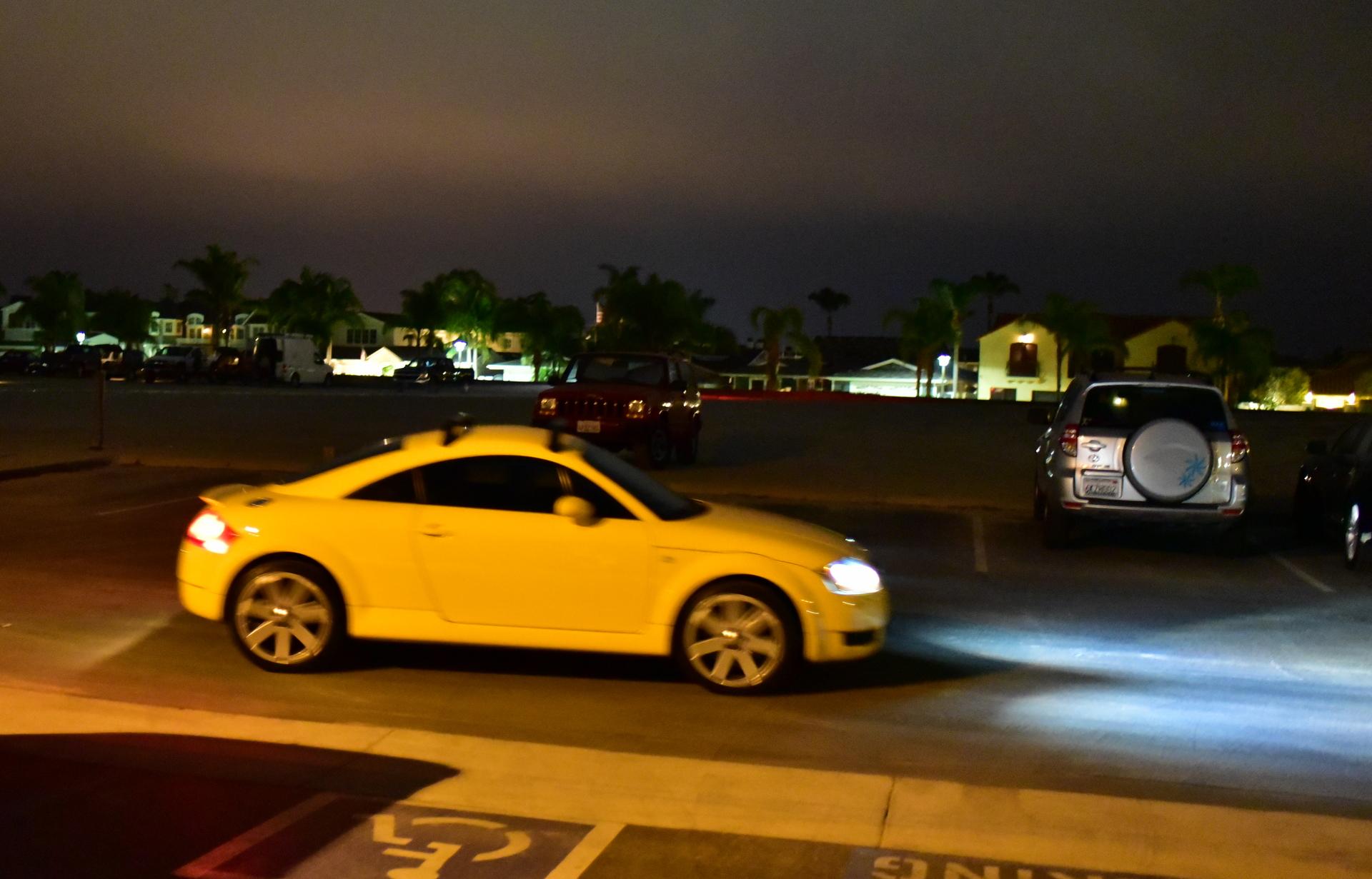 car driving through the Newport Aquatic Center parking lot at night