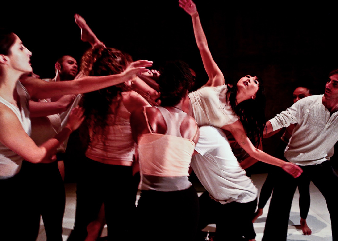 dance photo of Kim Thompson floating across a chorus of dancers in LA Contemporary Dance Company's production of Into The Fray