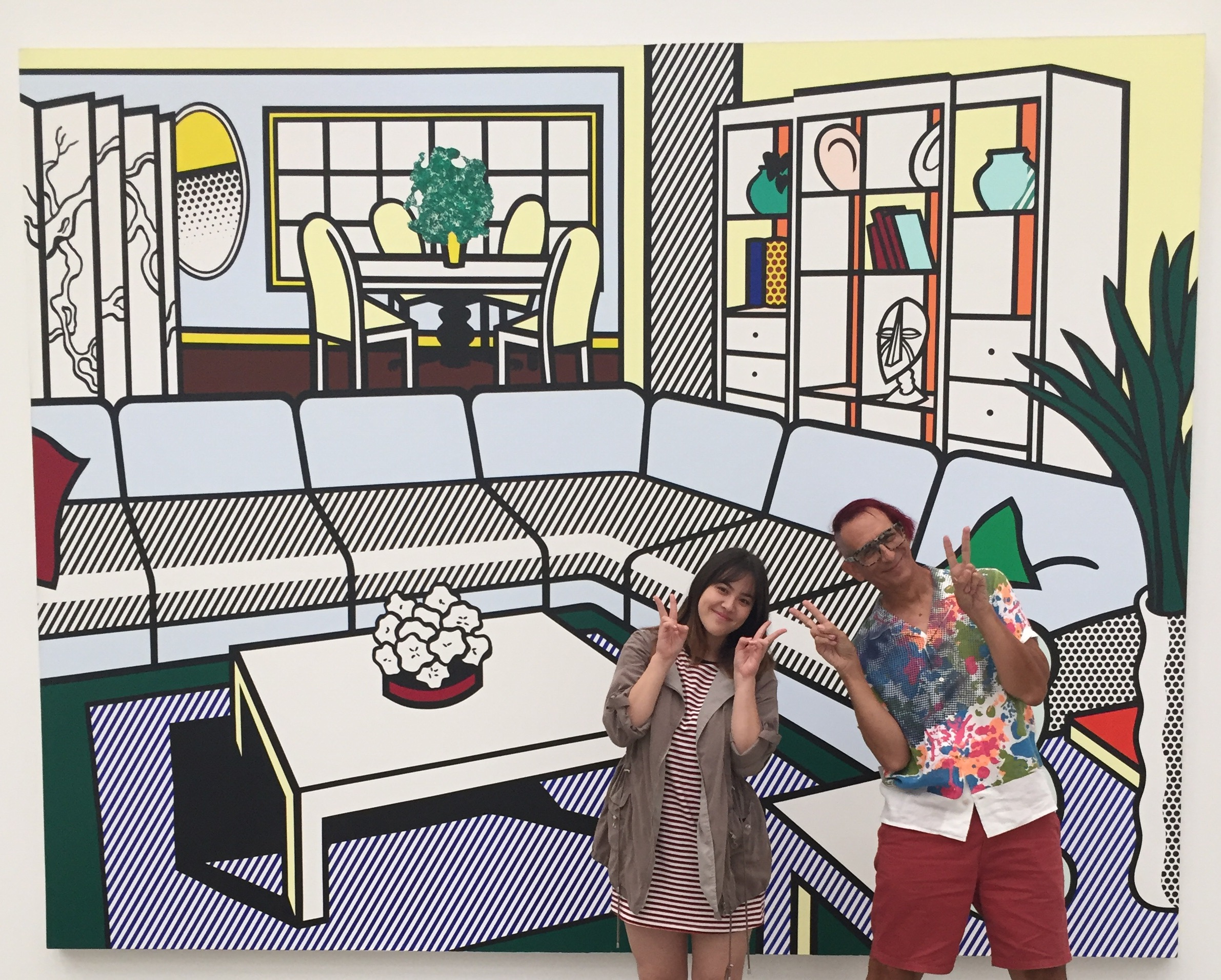 Lisa Bernhauser & Glenn Zucman in front of a large Roy Lichtenstein living room painting at The Broad Museum in Los Angeles
