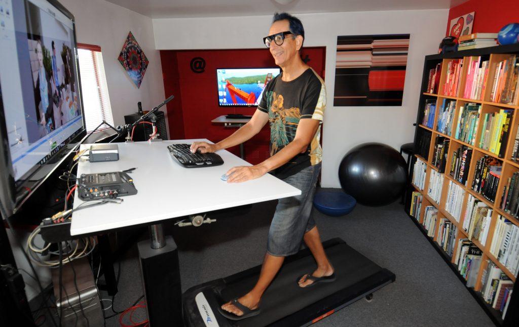 Glenn Zucman walking and typing at a treadmill desk