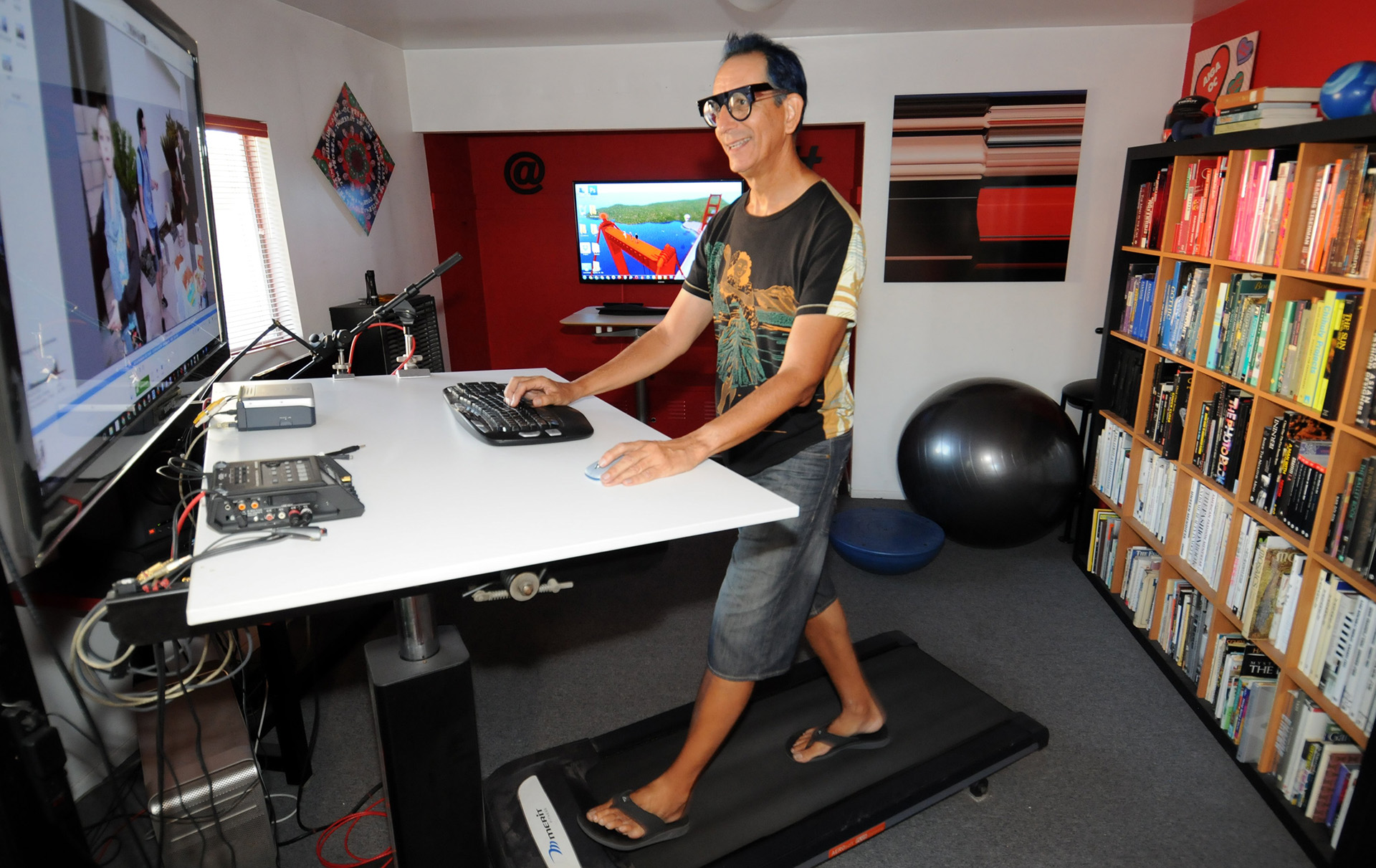"Glenn Zucman working on a Treadmill Desk with a 42"" drafting table, 46"" monitor, and nVidia GeForce 770 graphics workstation"