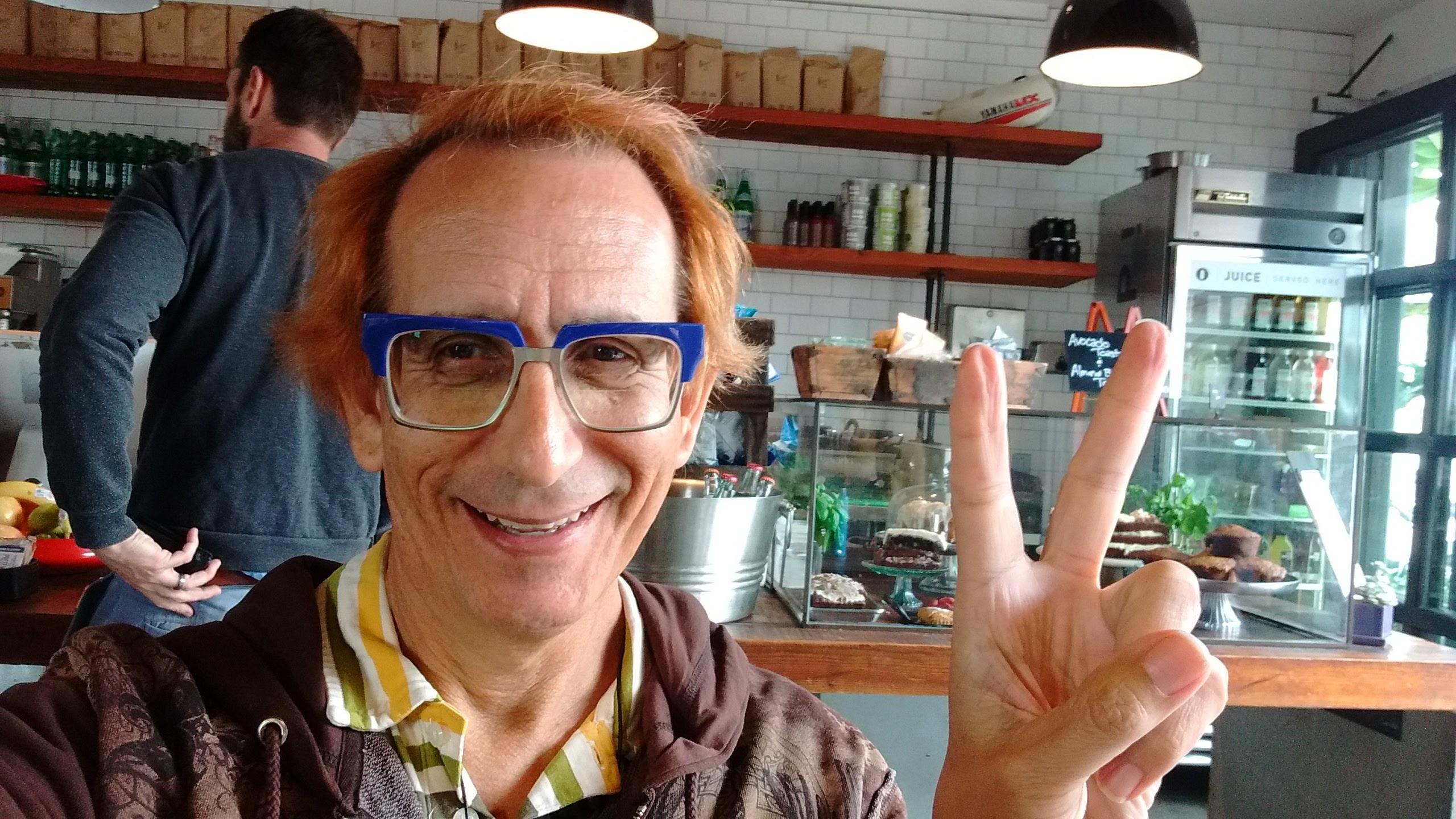 Glenn Zucman drinking chai-latte and writing a letter to Carla Dauden at Deus Ex Machina in Venice, CA