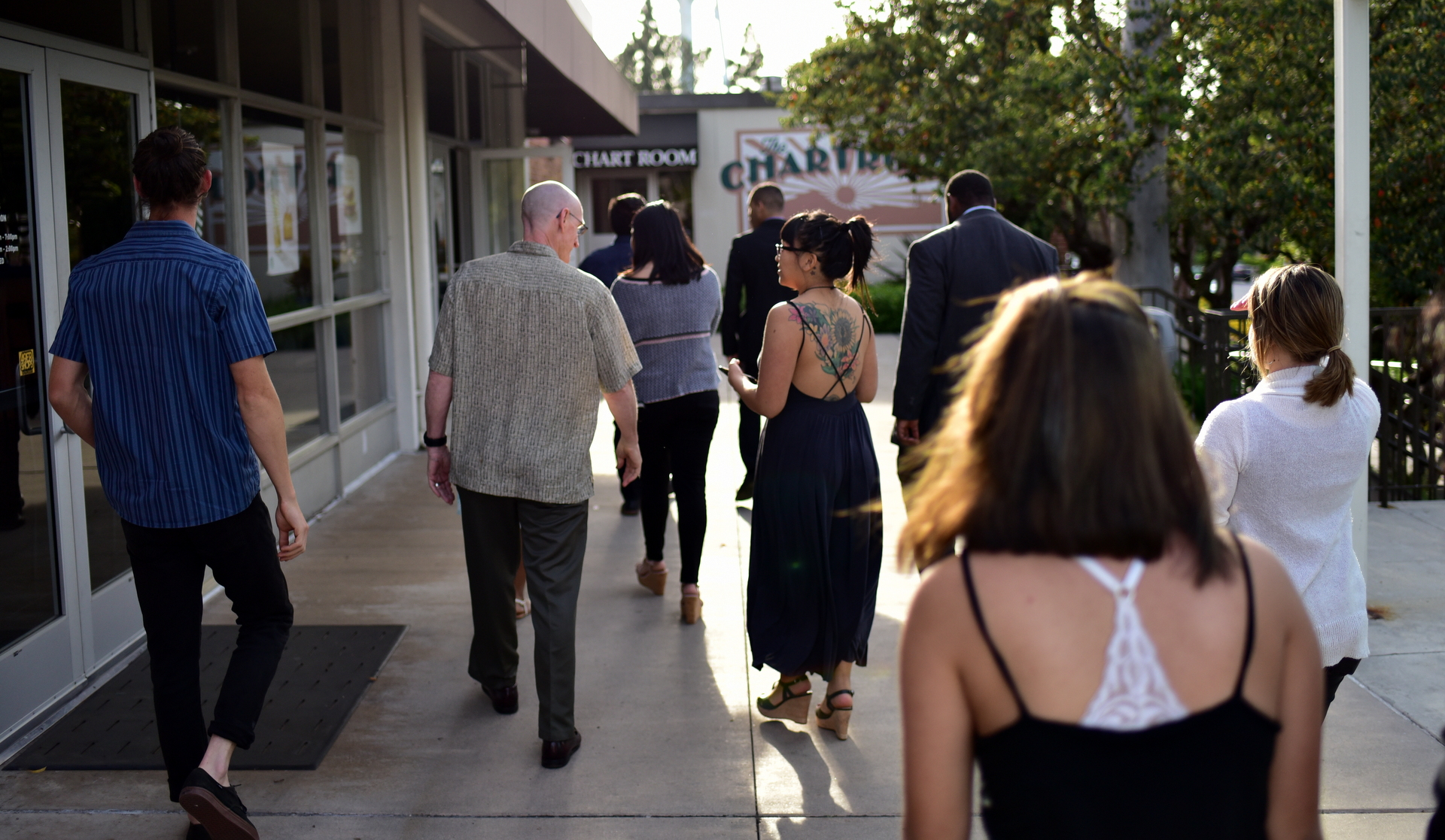 TEDxCSULB '17 speakers and organizers walking toward the CSULB Chartroom for dinner