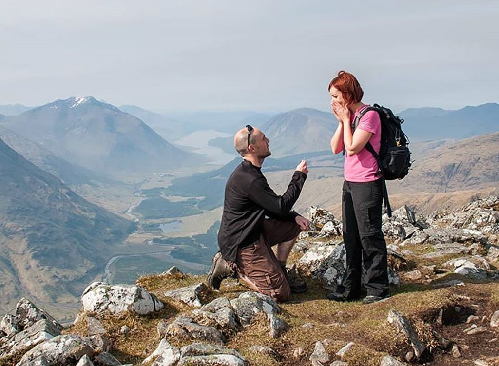 photo of Simon Baxter proposing to his fiance on a mountaintop. Tripod self-timer photo.