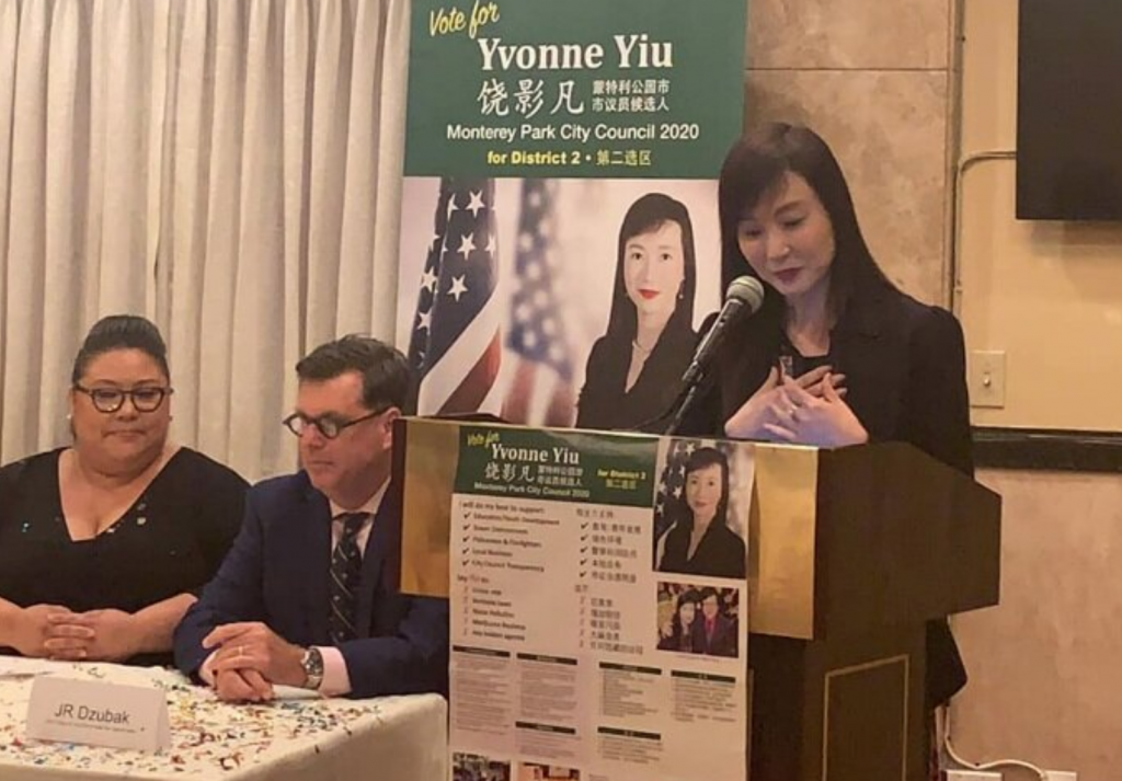 image of Yvonne Yiu speaking at a podium