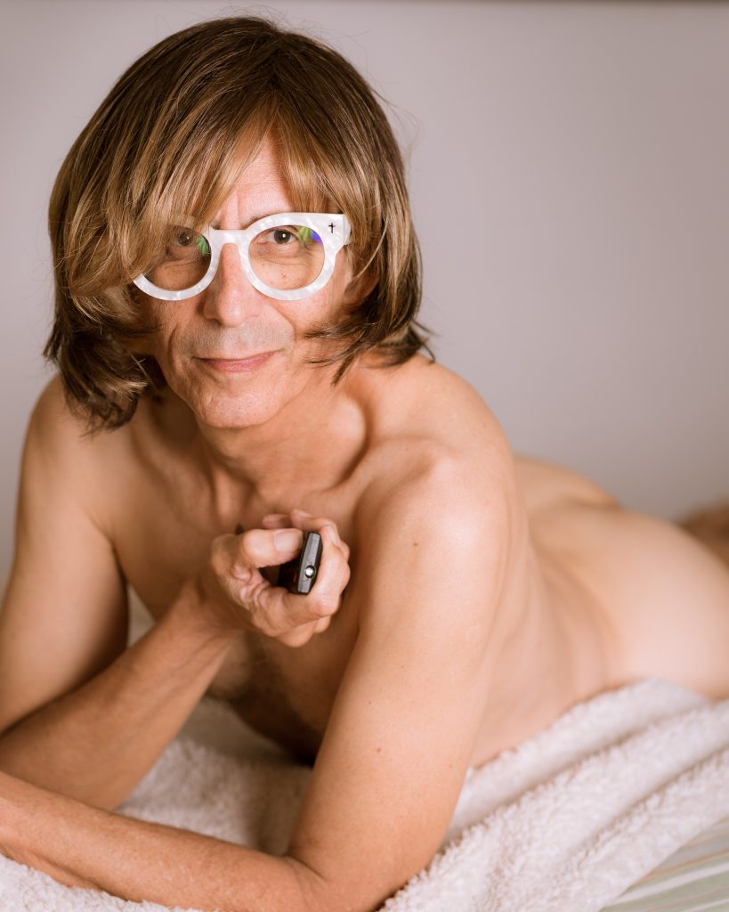 Glenn Zucman performing Jennifer Aniston's pose from the cover of Rolling Stone Magazine, 1996.