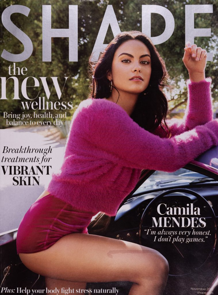 Camila Mendes posing on the cover of Shape Magazine, November 2018.