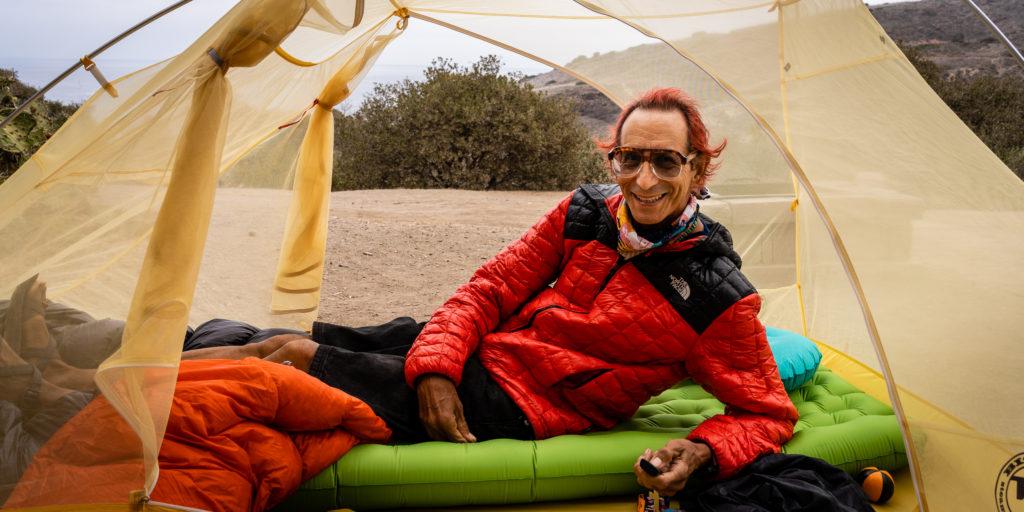 Glenn Zucman reclining in a tent at the campground at Two Harbors, Santa Catalina Island