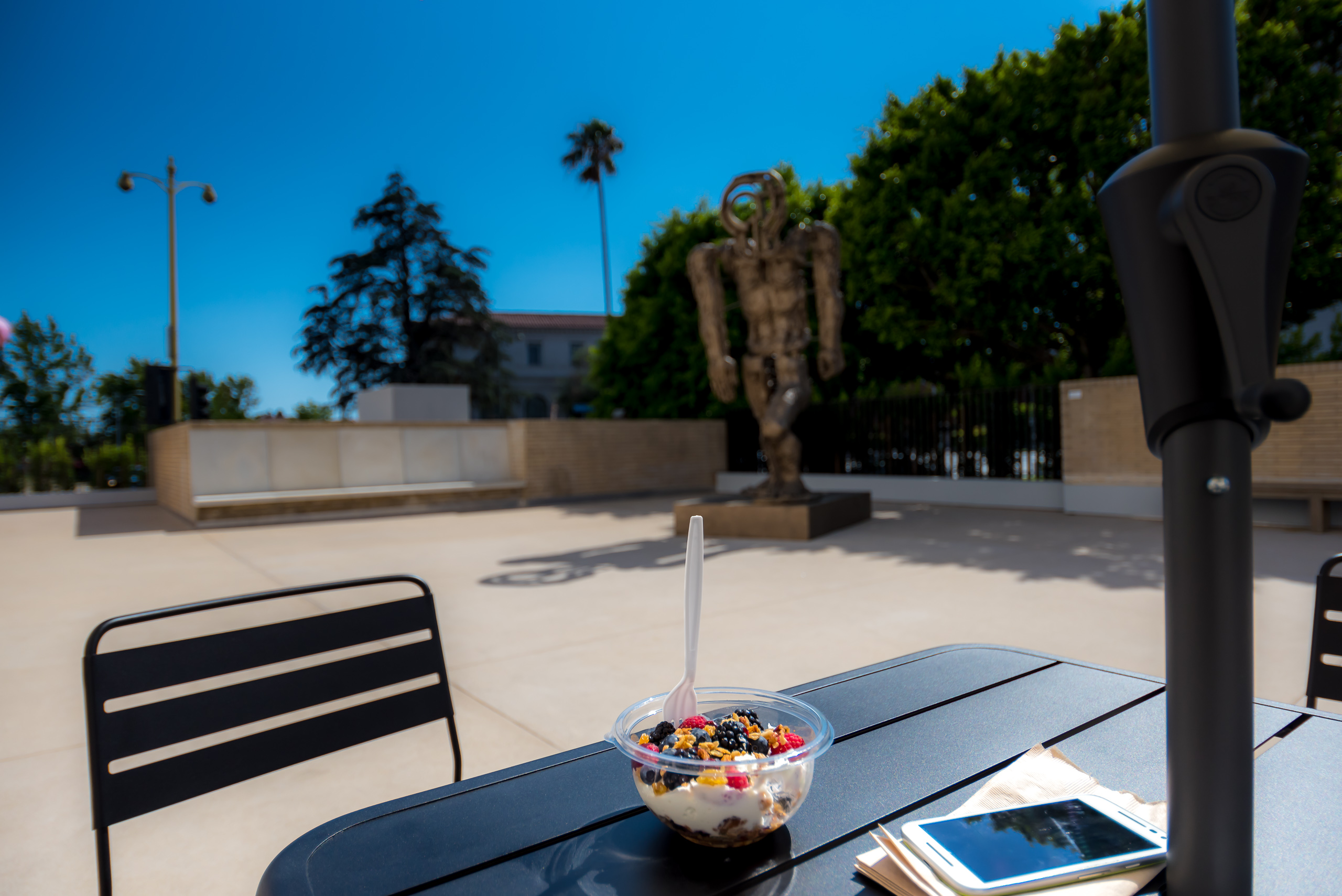 A yogurt and fruit bowl on a patio table in the courtyard of the Marciano Art Foundation on Wilshire Blvd in Los Angeles