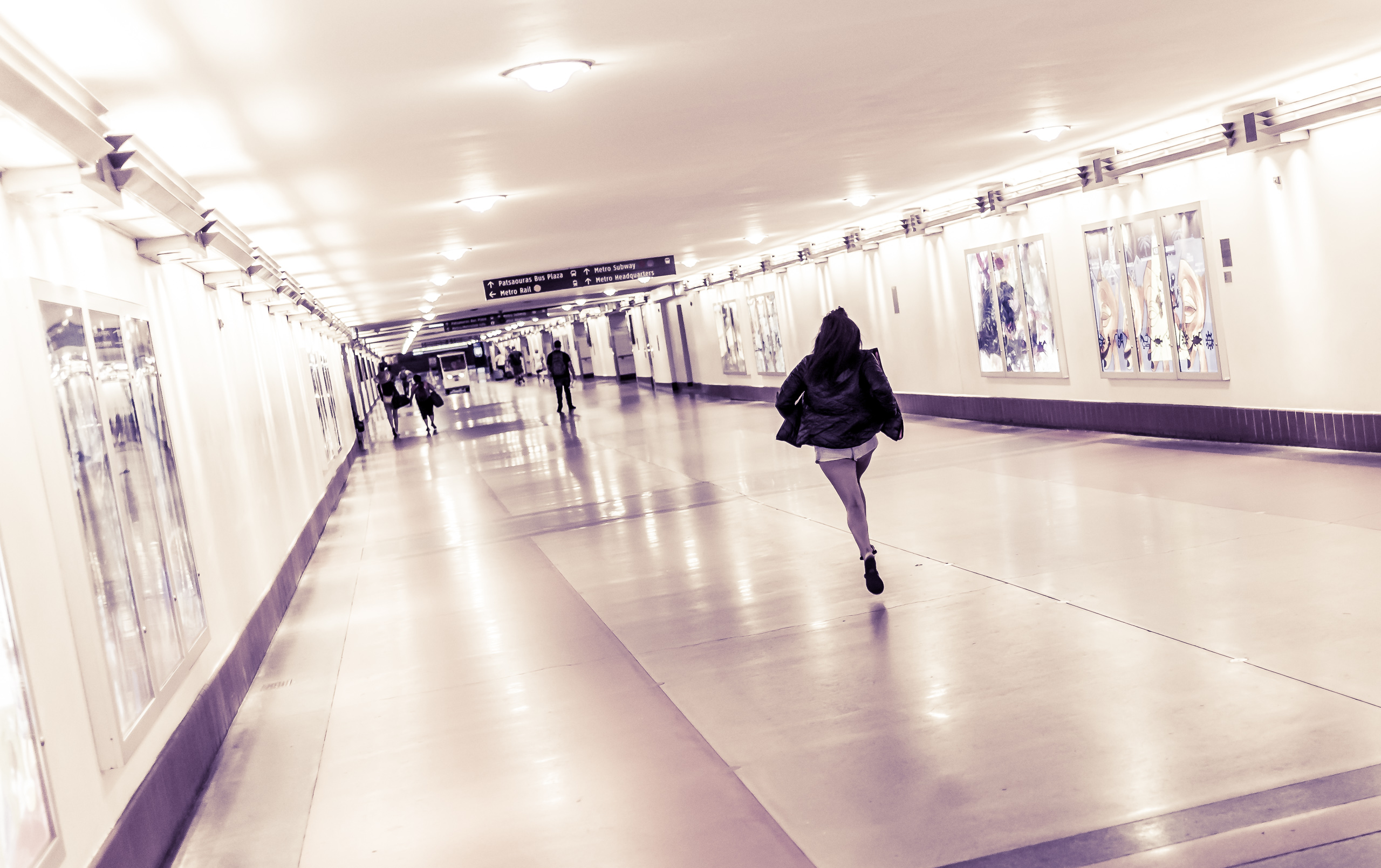 A person running down the length of an empty Union Station main corridor