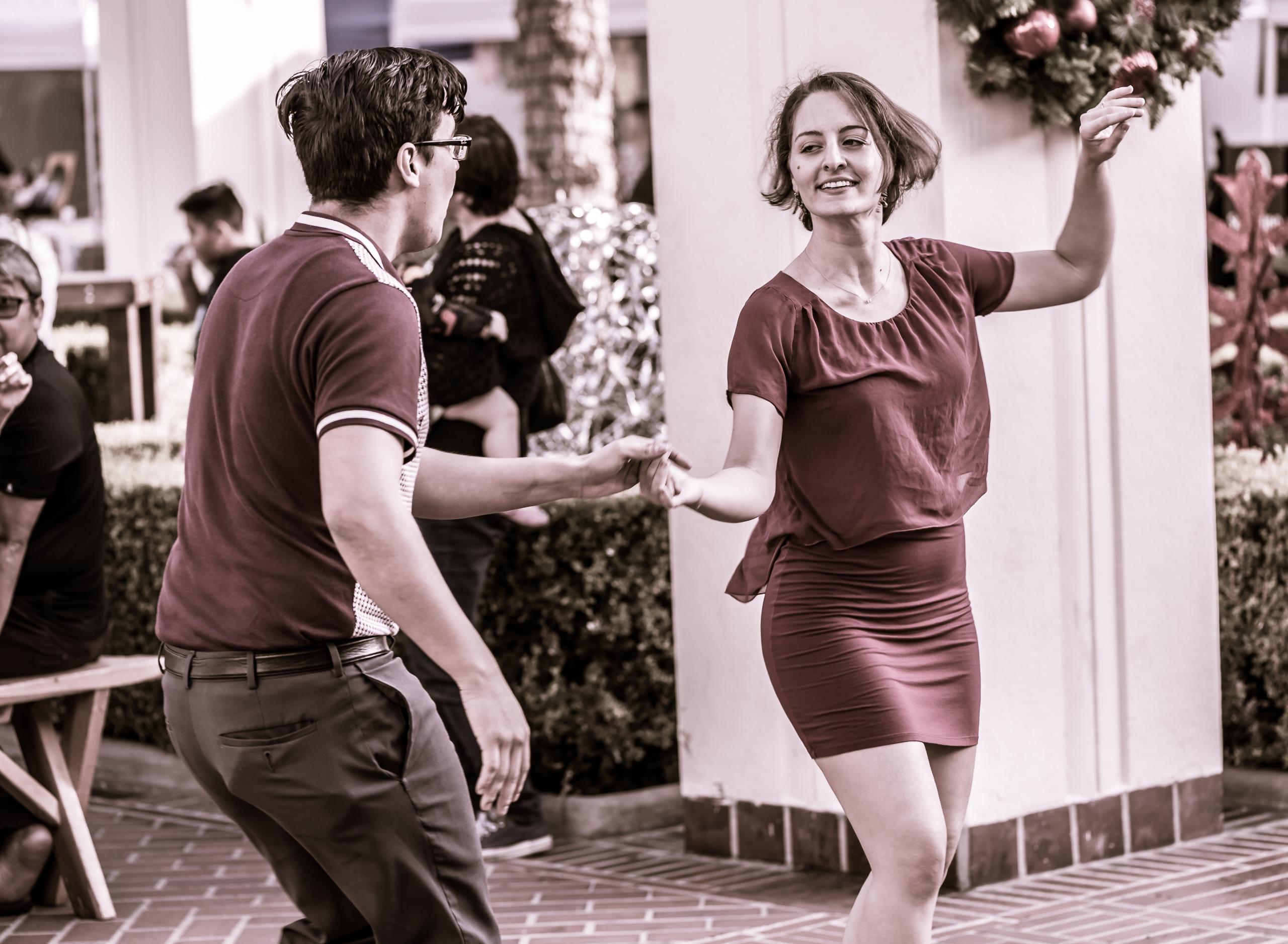 a couple dancing in an open-air courtyard