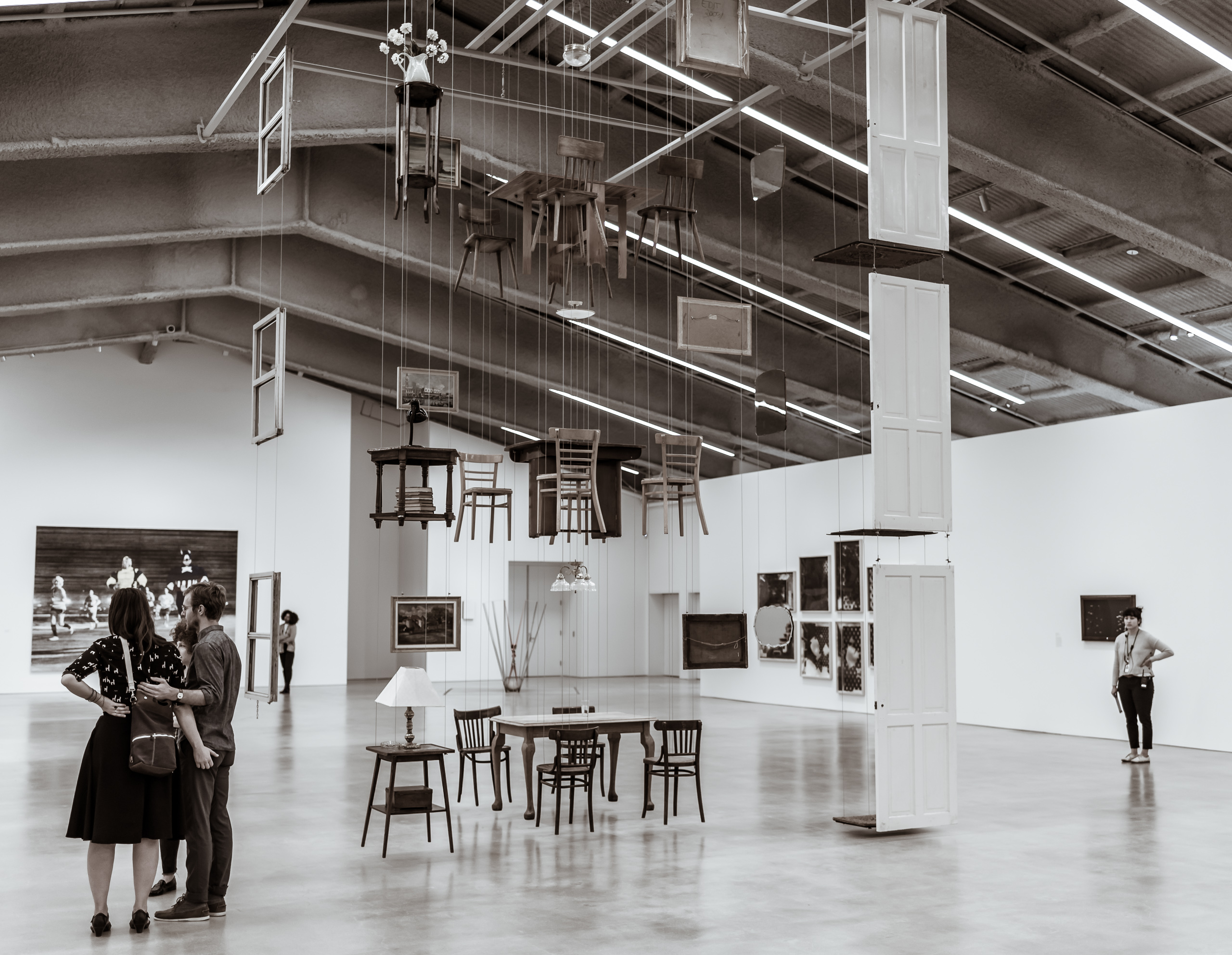 "suspended in a large gallery at the Marciano Art Foundation is Damián Ortega's ""Architecture without Architects"" - an ""exploded"" view of a 3 story home. Elements like doors and tables and chairs hang in the space like pieces on a 3-dimensional chess board"