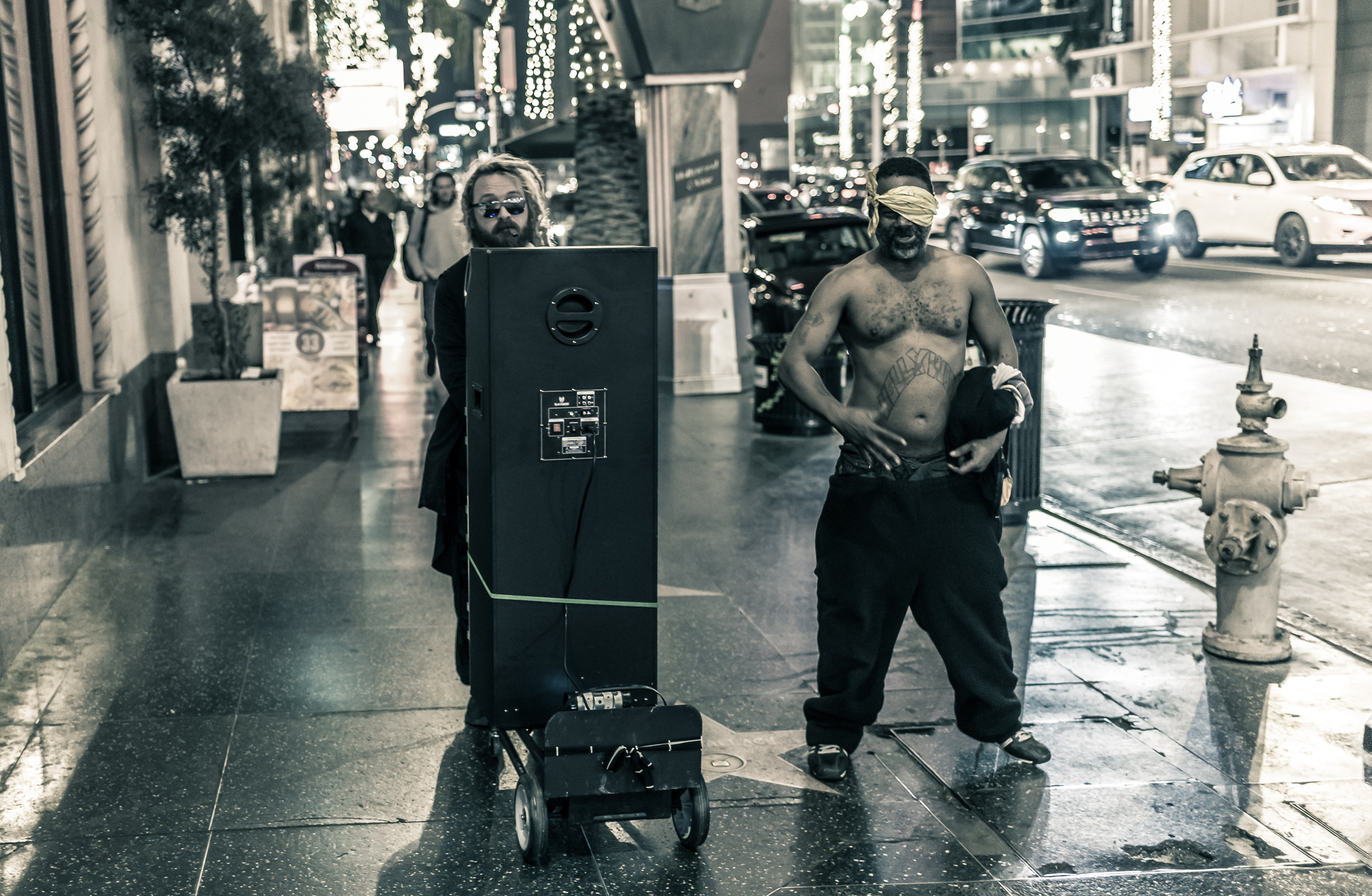 Sometimes you just have to put on a suit, plug your phone into a giant speaker, and wheel it down Hollywood Blvd as some shirtless guy with a bandana-eye-patch dances alongside you, 8:54pm
