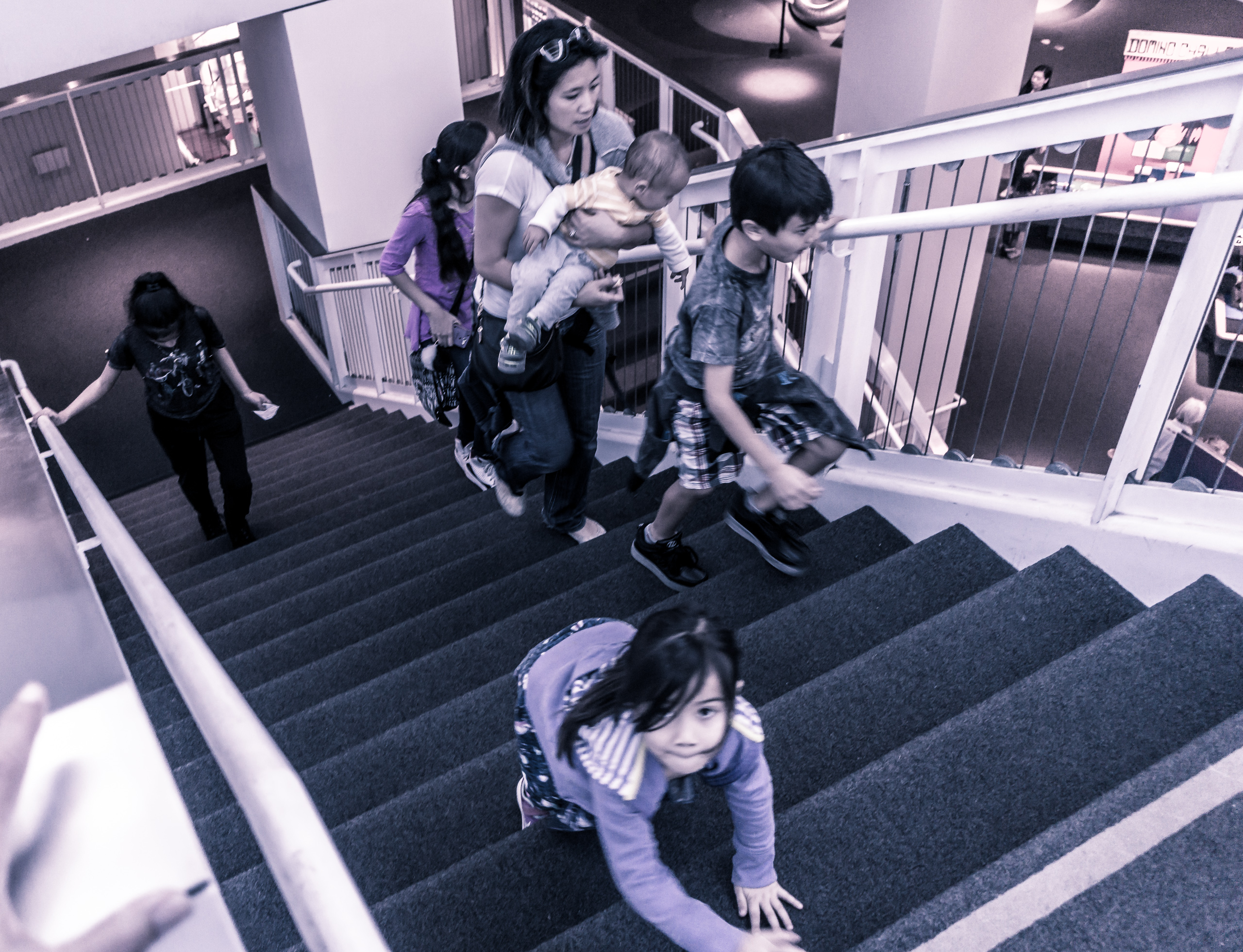 a child climbs the stairs at the California Science Center in Exposition Park in Los Angeles