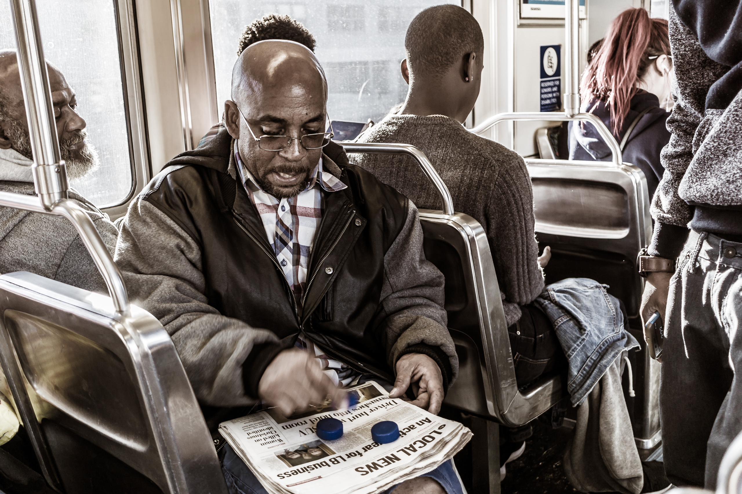 a Metro rider plays a shell game with bottle caps