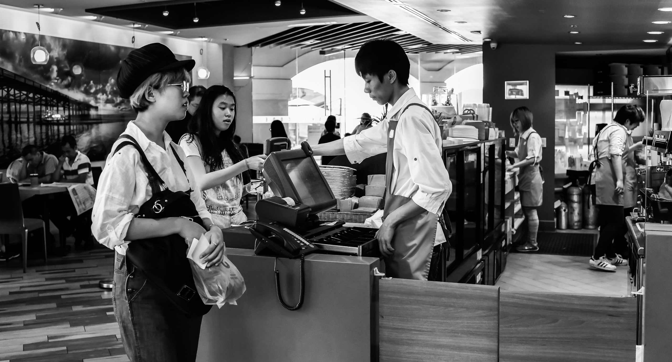 customers at the register at Bake Code in New Taipei, CA