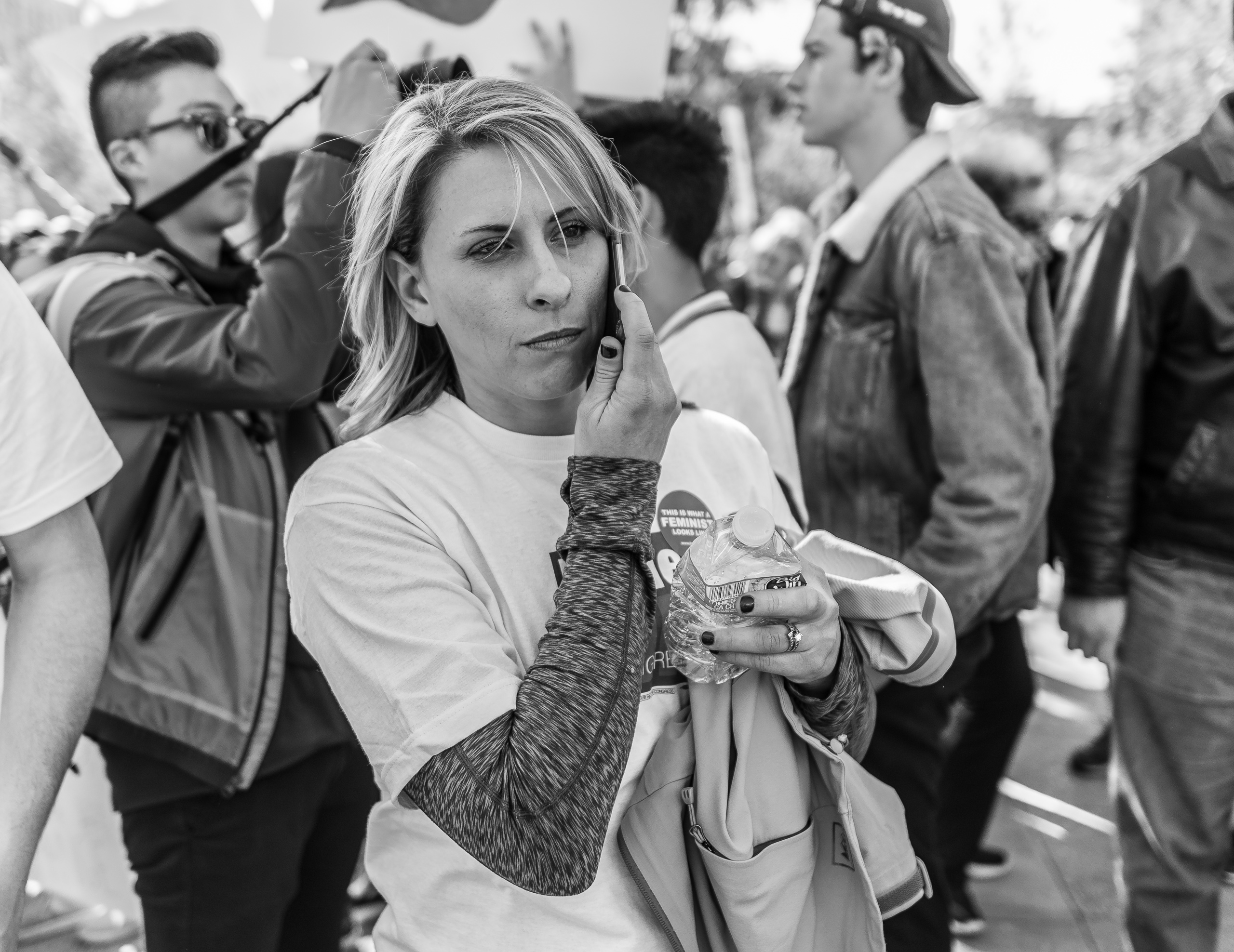 Katie Hill on a cell phone at the Women's March Los Angeles 2018