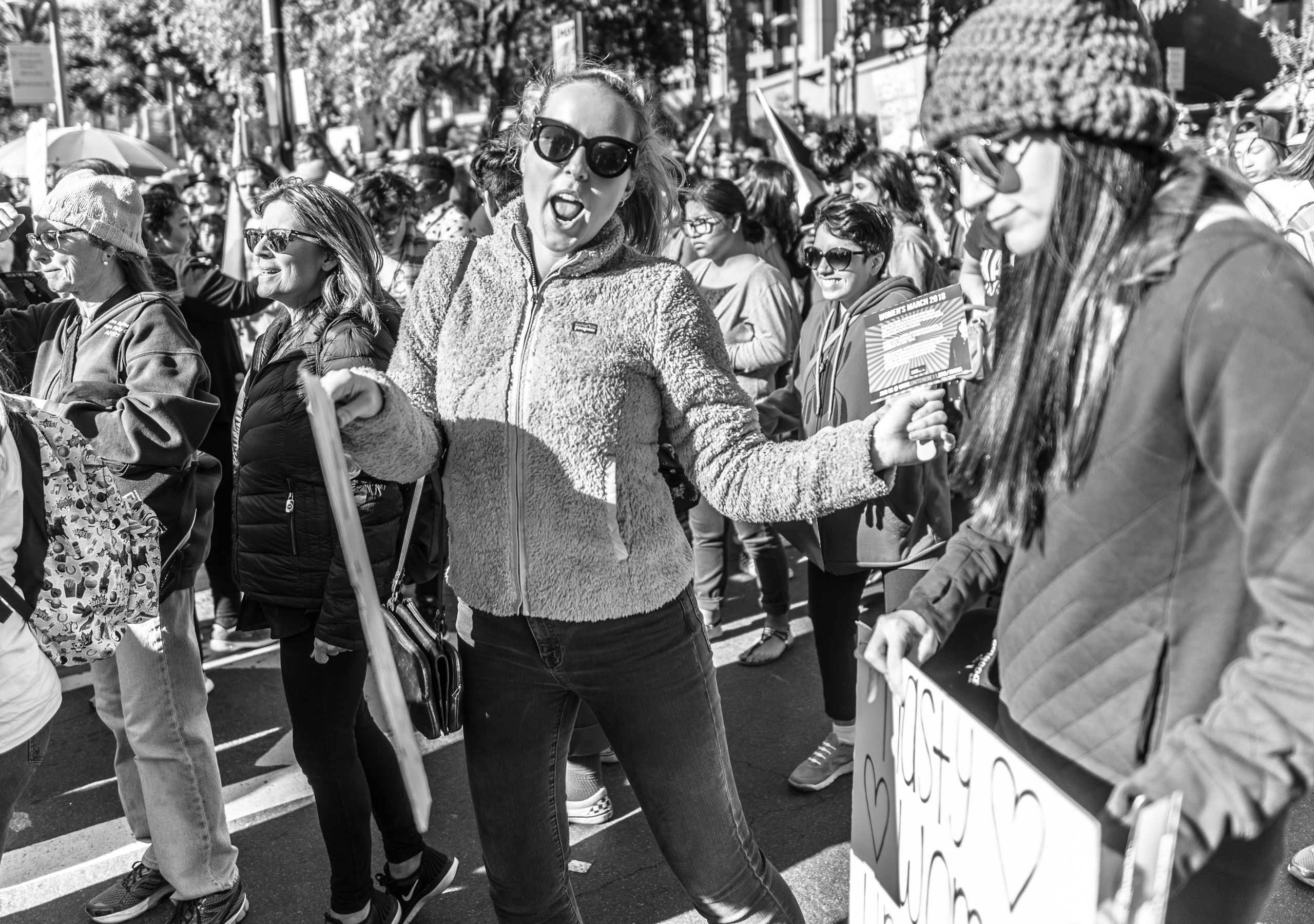 a woman dances in the street at the 2018 Los Angeles Women's March