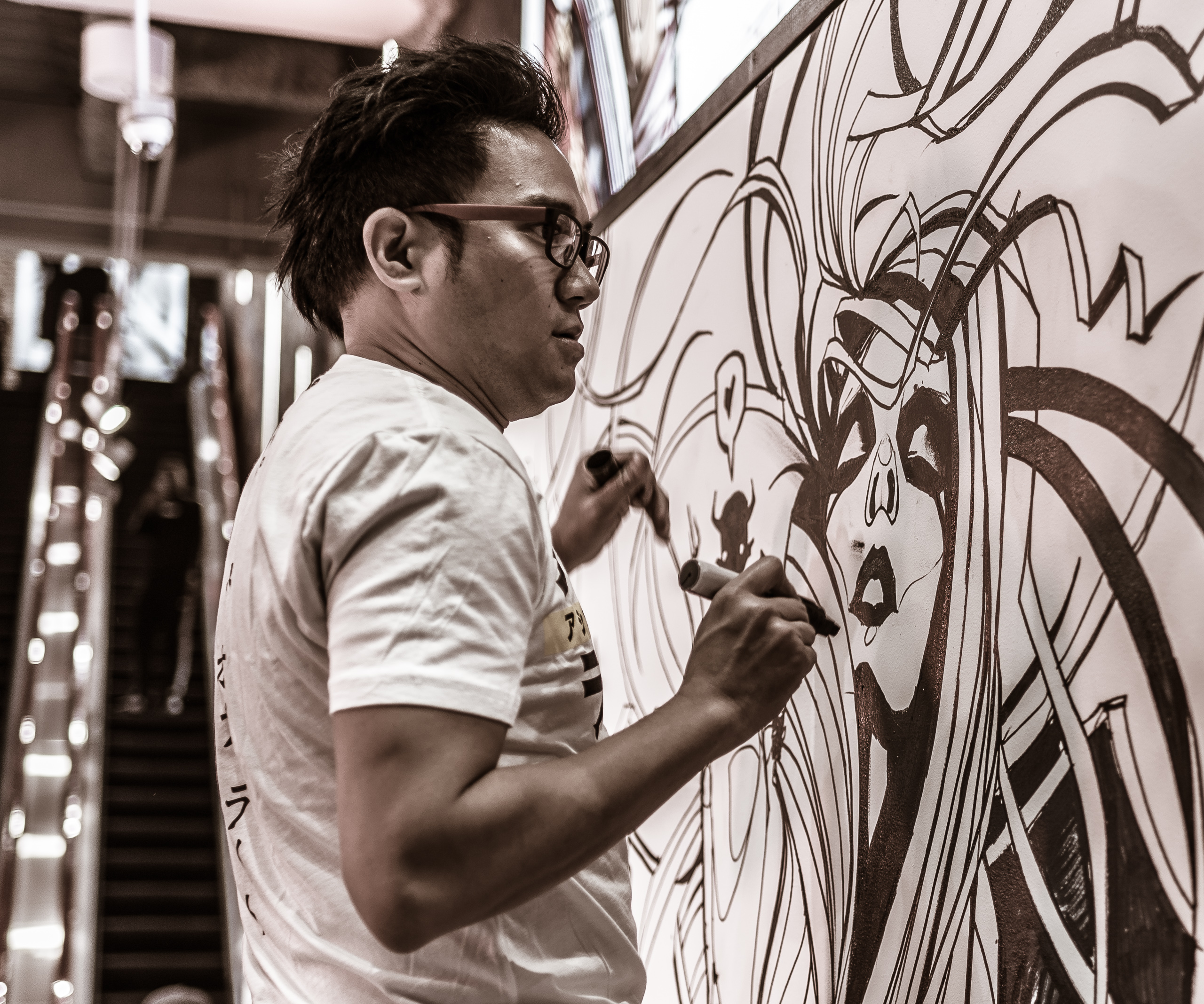 Patrick Ballesteros of Secret Walls painting at Footlocker on Hollywood & Highland in Hollywood, Los Angeles, California