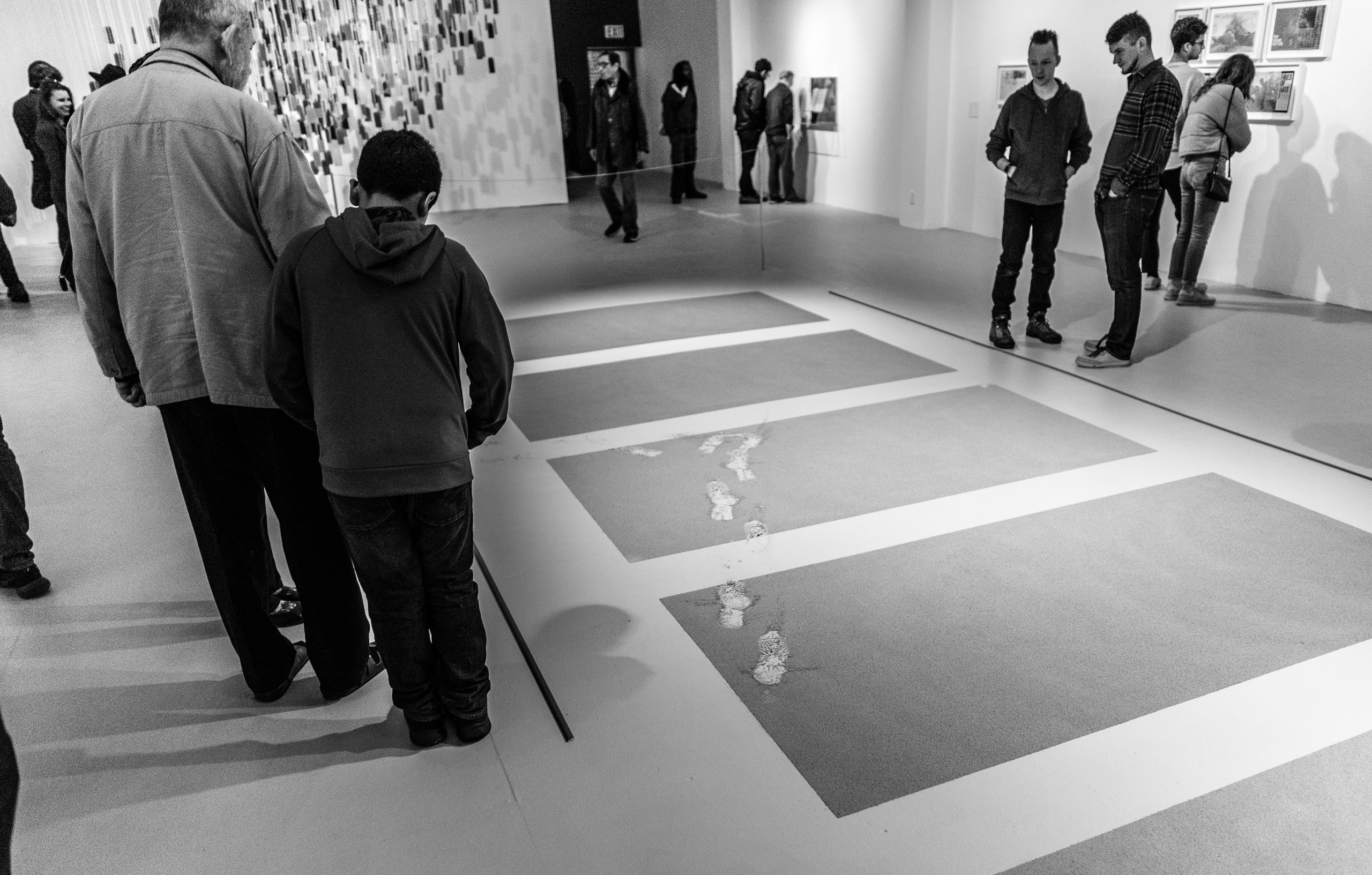installation view at LACE (Los Angeles Contemporary Exhibitions) showing a grid of ashes on the gallery floor and accidental footprints walking across them