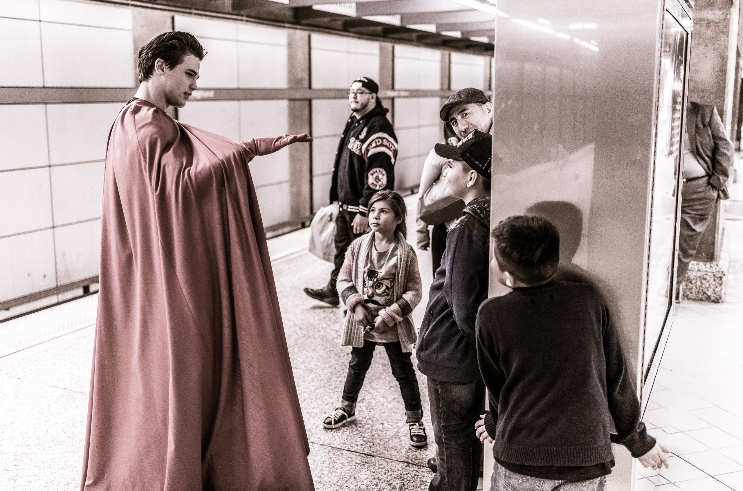 """Superman"" talks to young kids as they wait on the platform at the LA Metro's Red Line station at Hollywood & Highland"