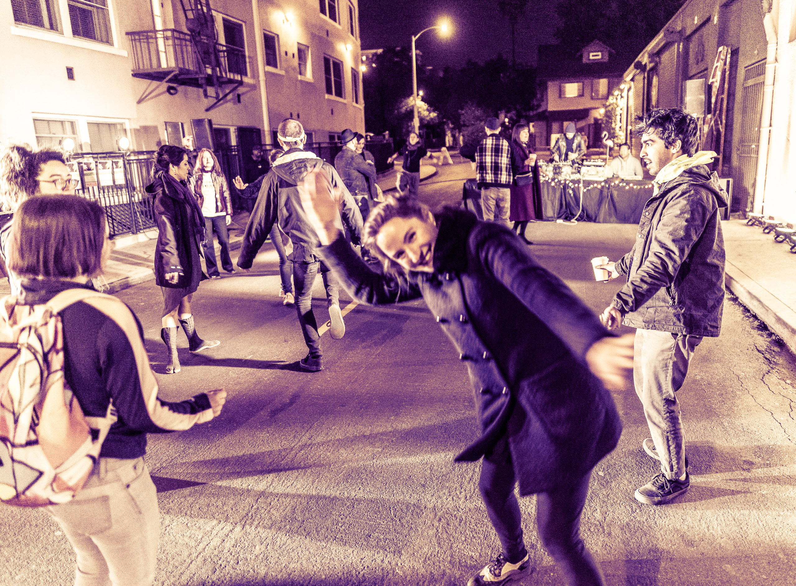 a group of people dancing on Hudson Ave in Hollywood, across the street from LACE (Los Angeles Contemporary Exhibitions)