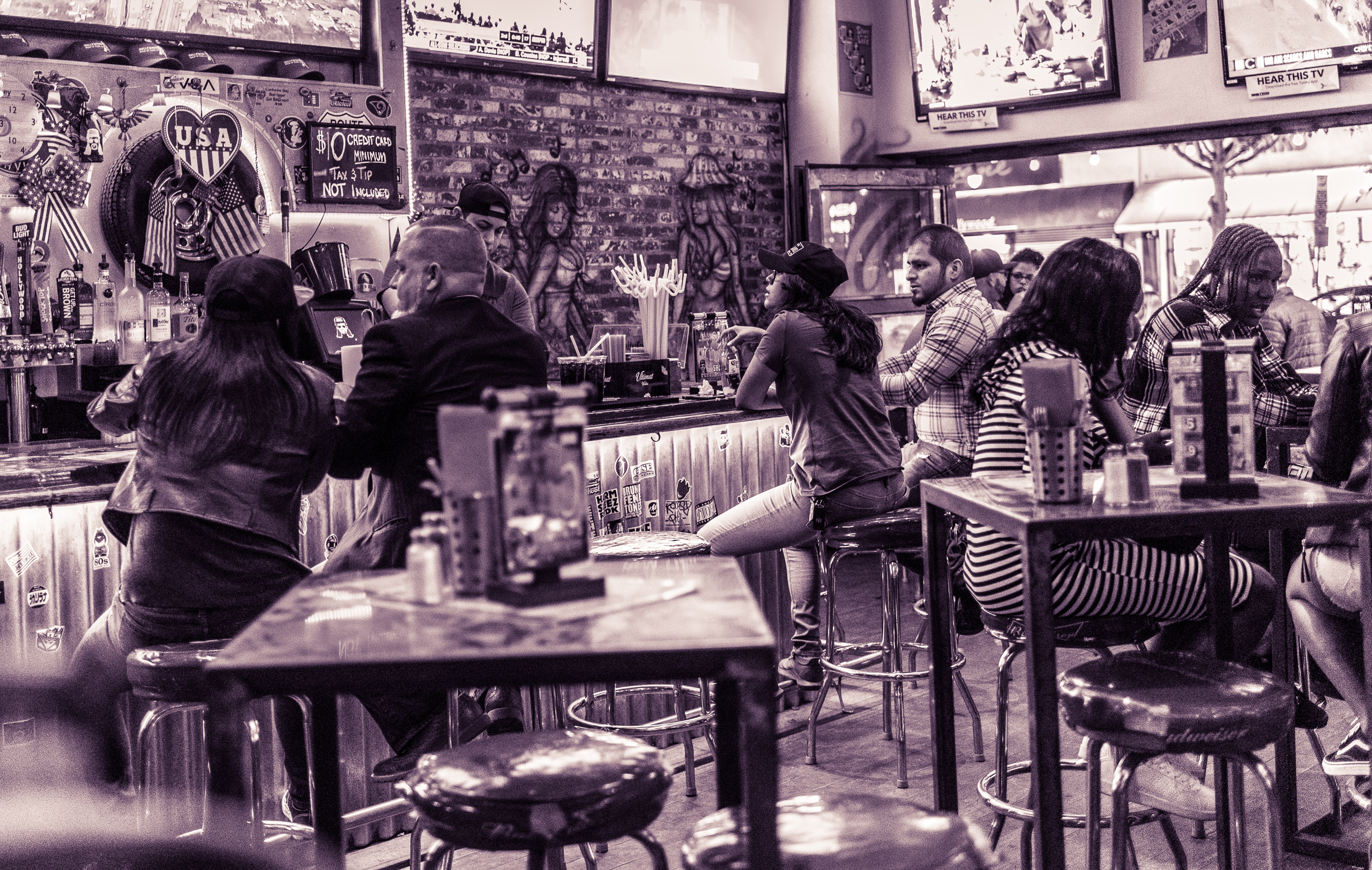 customers sit around the interior space of the Rusty Mullet bar & restaurant on Hollywood Blvd.