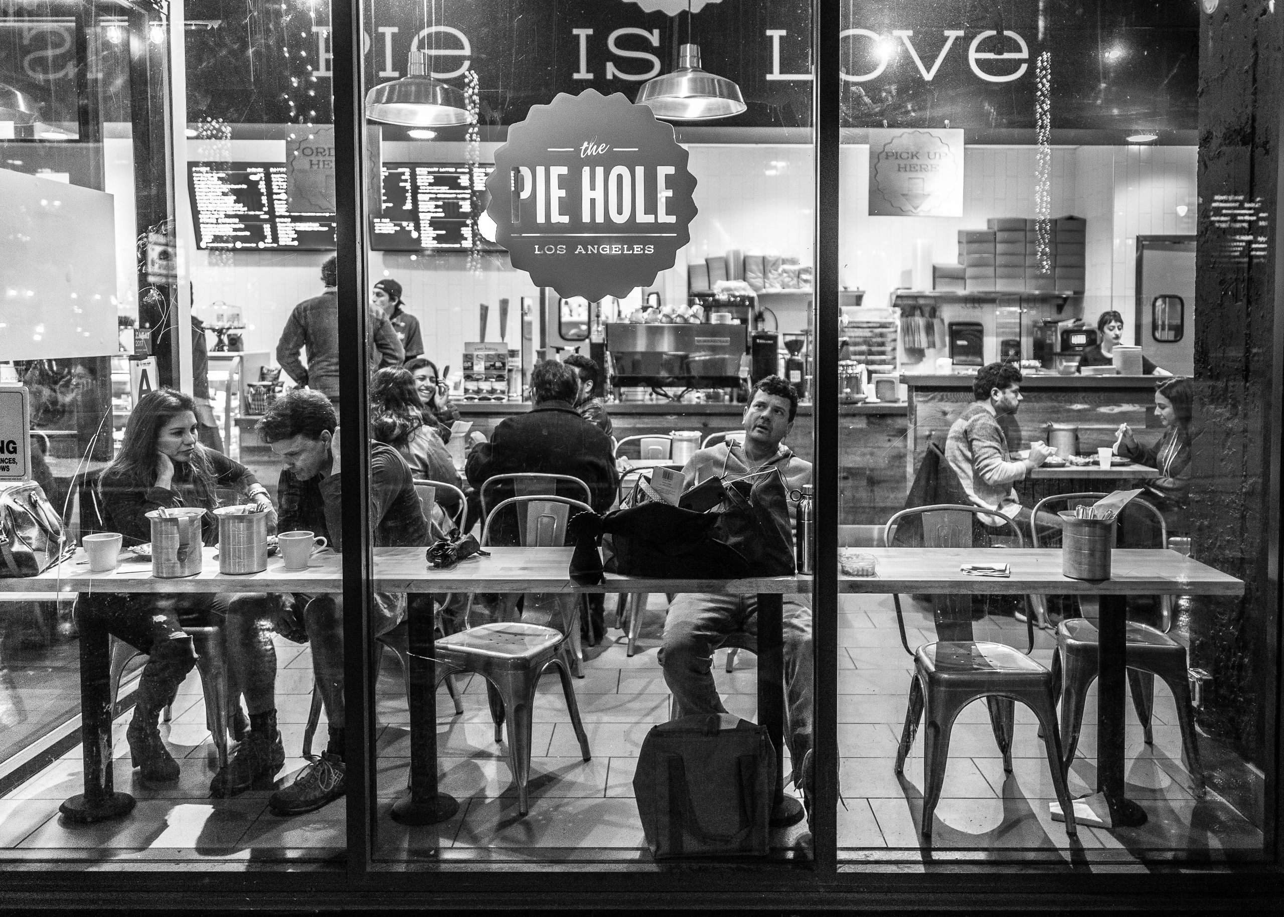The Pie Hole, Los Angeles, on Hollywood Blvd near Vine. View looking in through large floor-to-ceiling windows of people eating pie