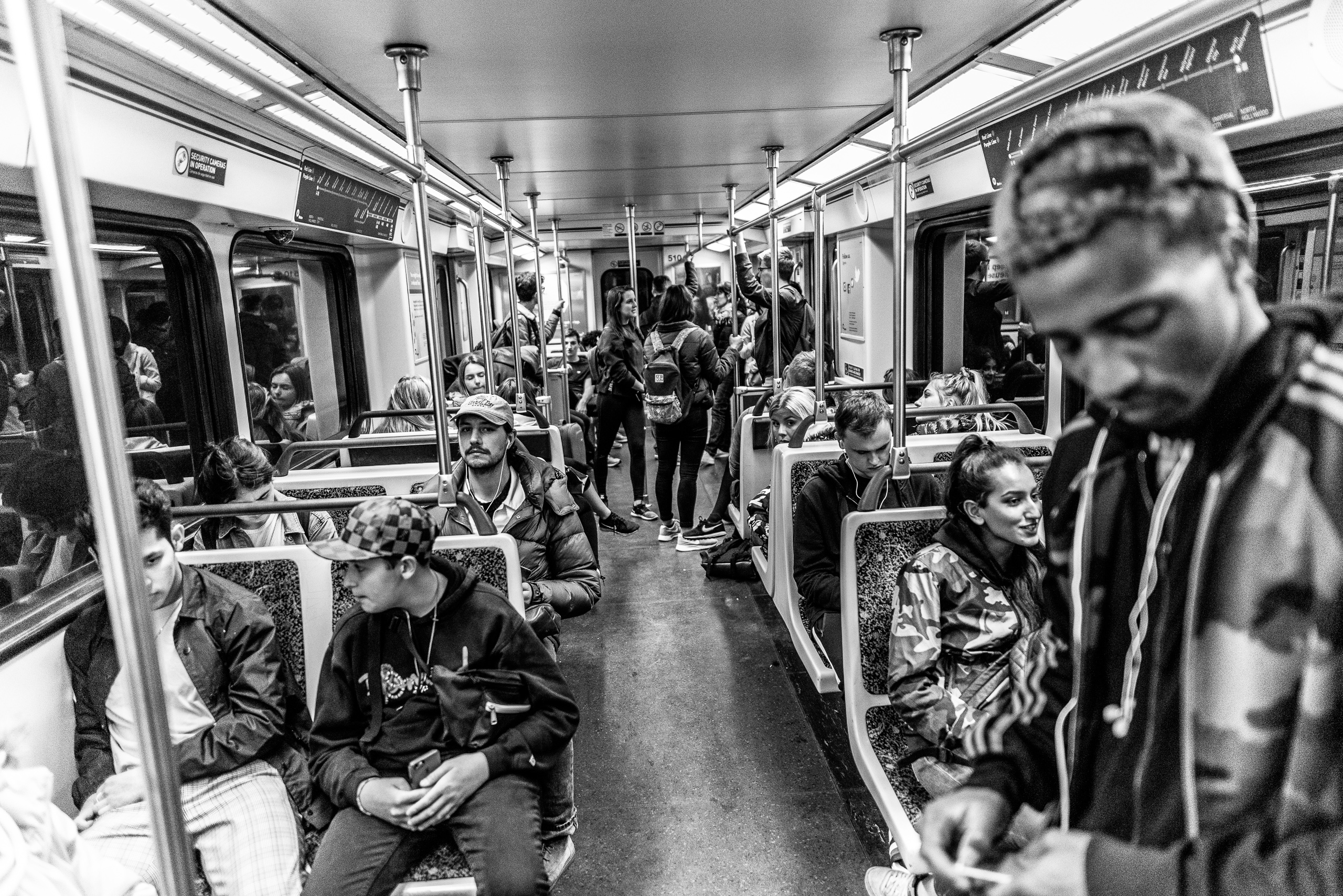 a full, but not overcrowded, Los Angeles Metro Red Line car heading from Hollywood toward Downtown Los Angeles