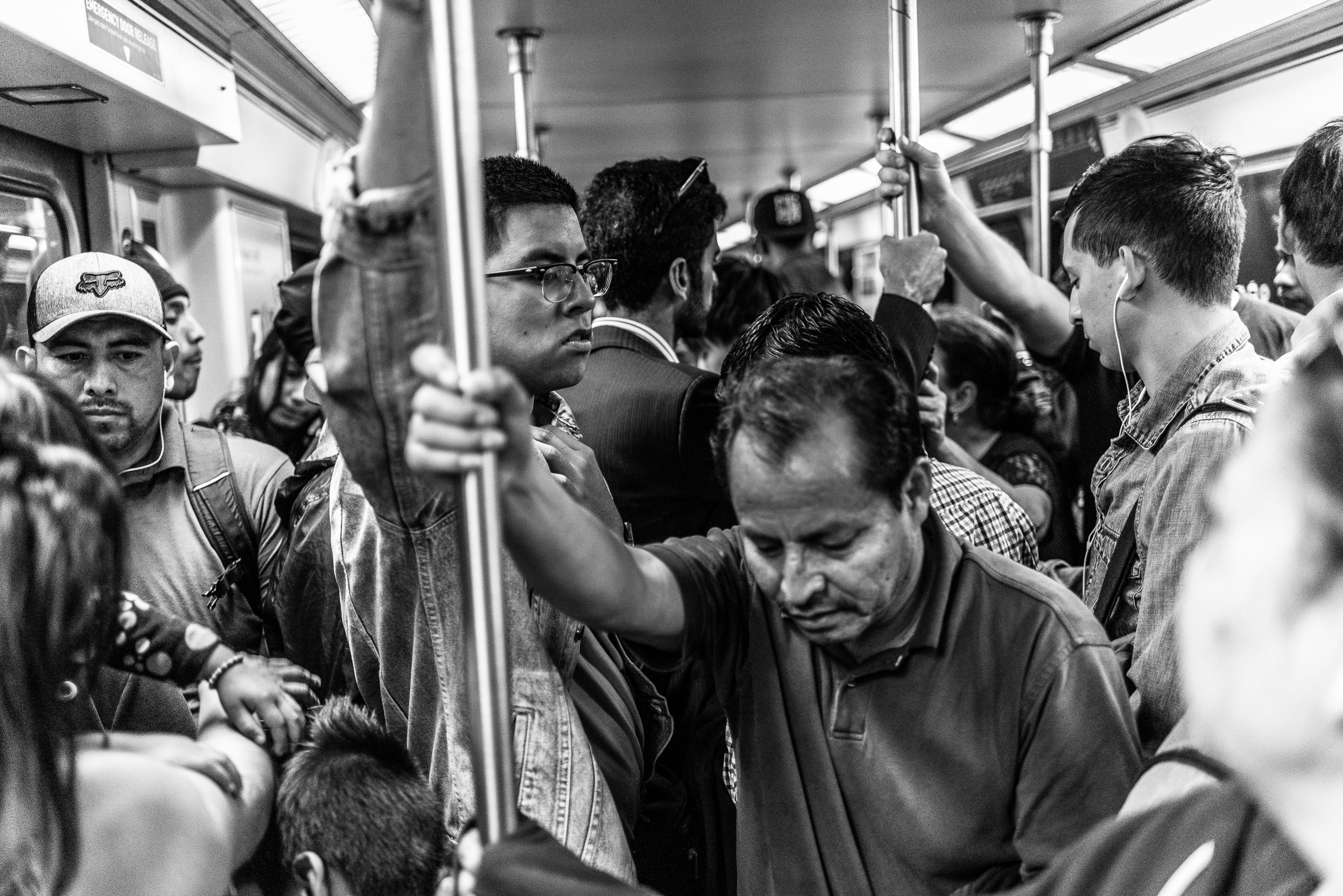 a very crowded car of the Los Angeles Metro Red Line heading out toward Hollywood