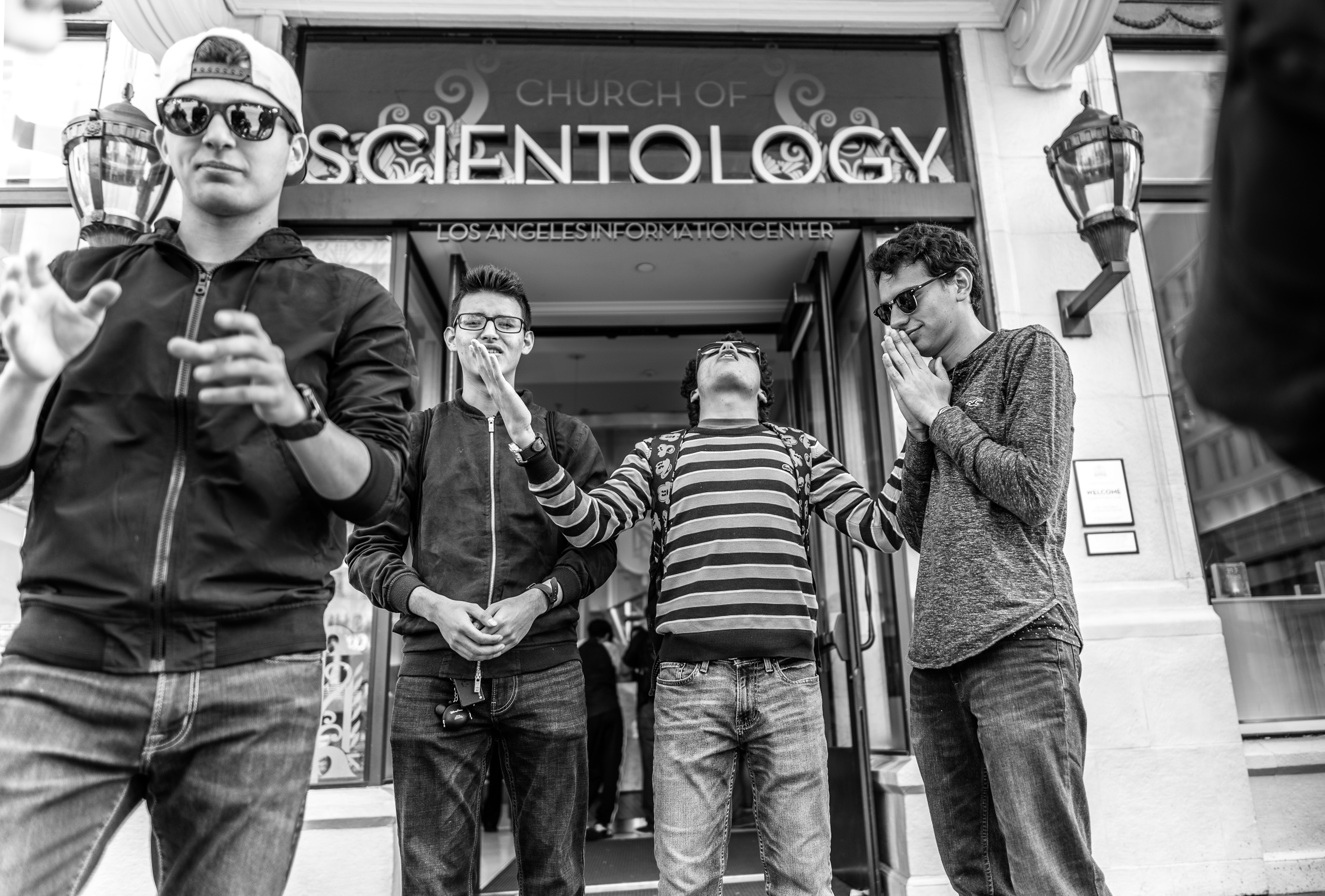 "4 guys stand ""praying"" in front of the Church of Scientology on Hollywood Blvd in Los Angeles, CA"