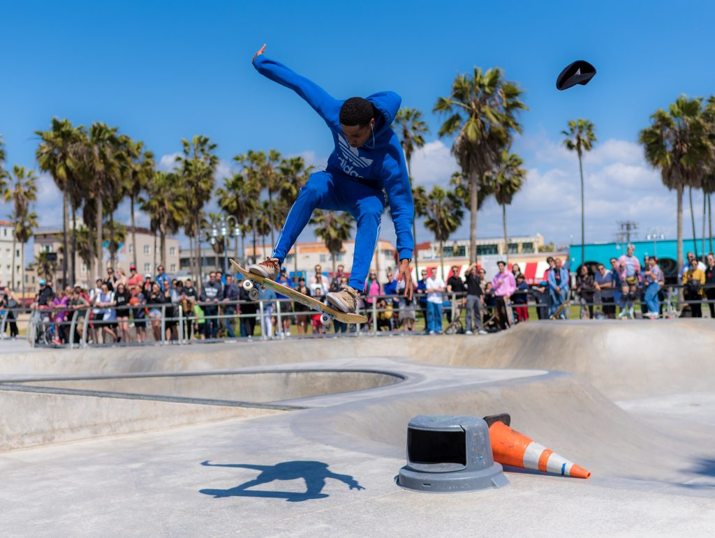a skateboarder flies high over a cone at the Venice Beach Skate Park in Venice, CA