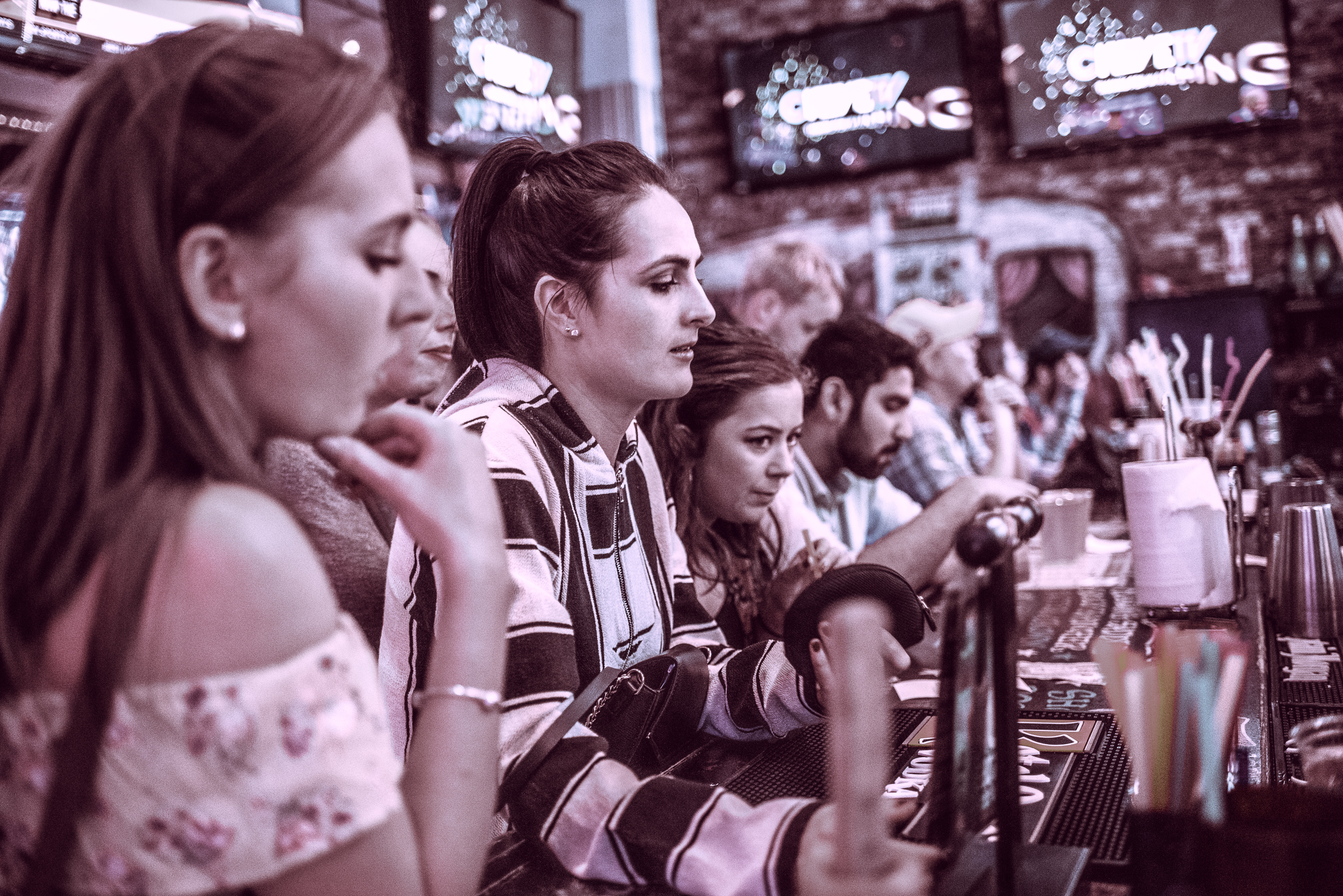 a group of women order drinks at the bar at Rusty Mullet on Hollwyood Blvd in Hollywood, Los Angeles, California
